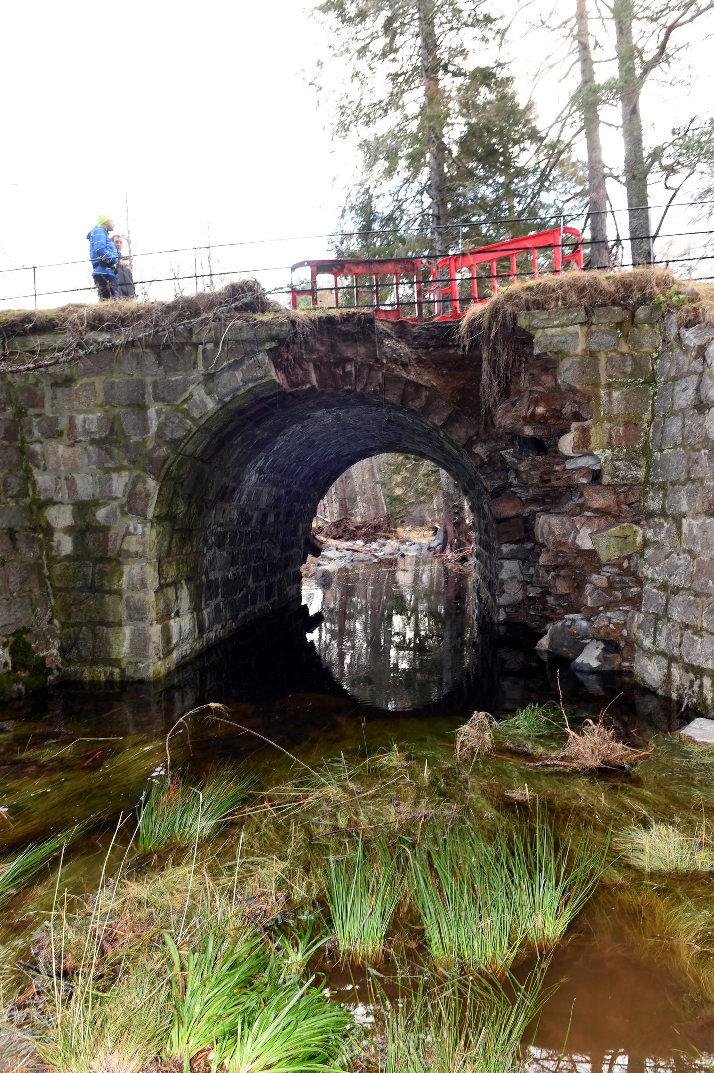 flood damage:  The Invercauld Bridge was badly hit in the floods. Below, Joanne Morris, owner of  Braemar Petrol Station.