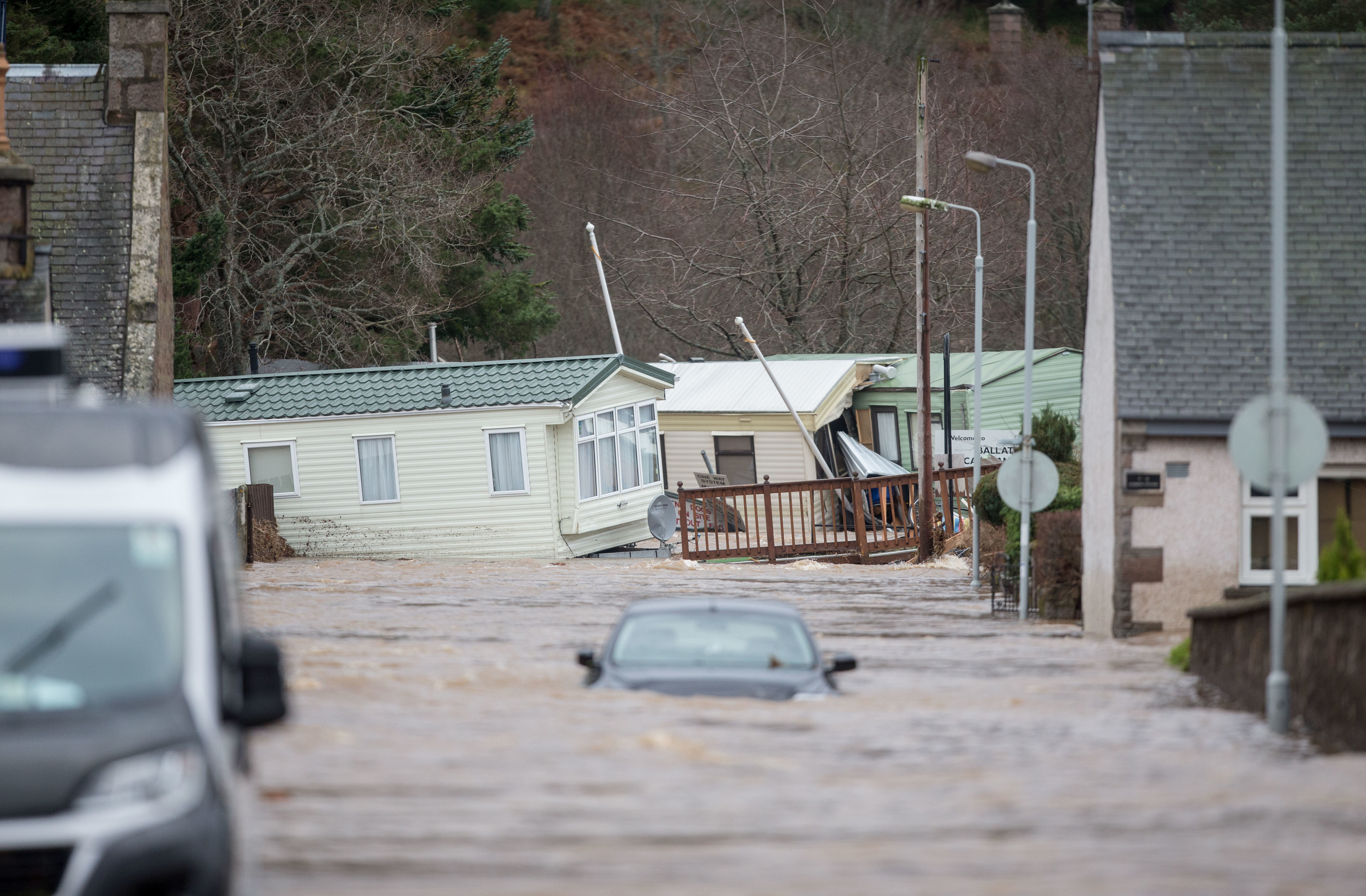 destruction :  Severe flooding in Ballater after the River Dee burst its banks.
