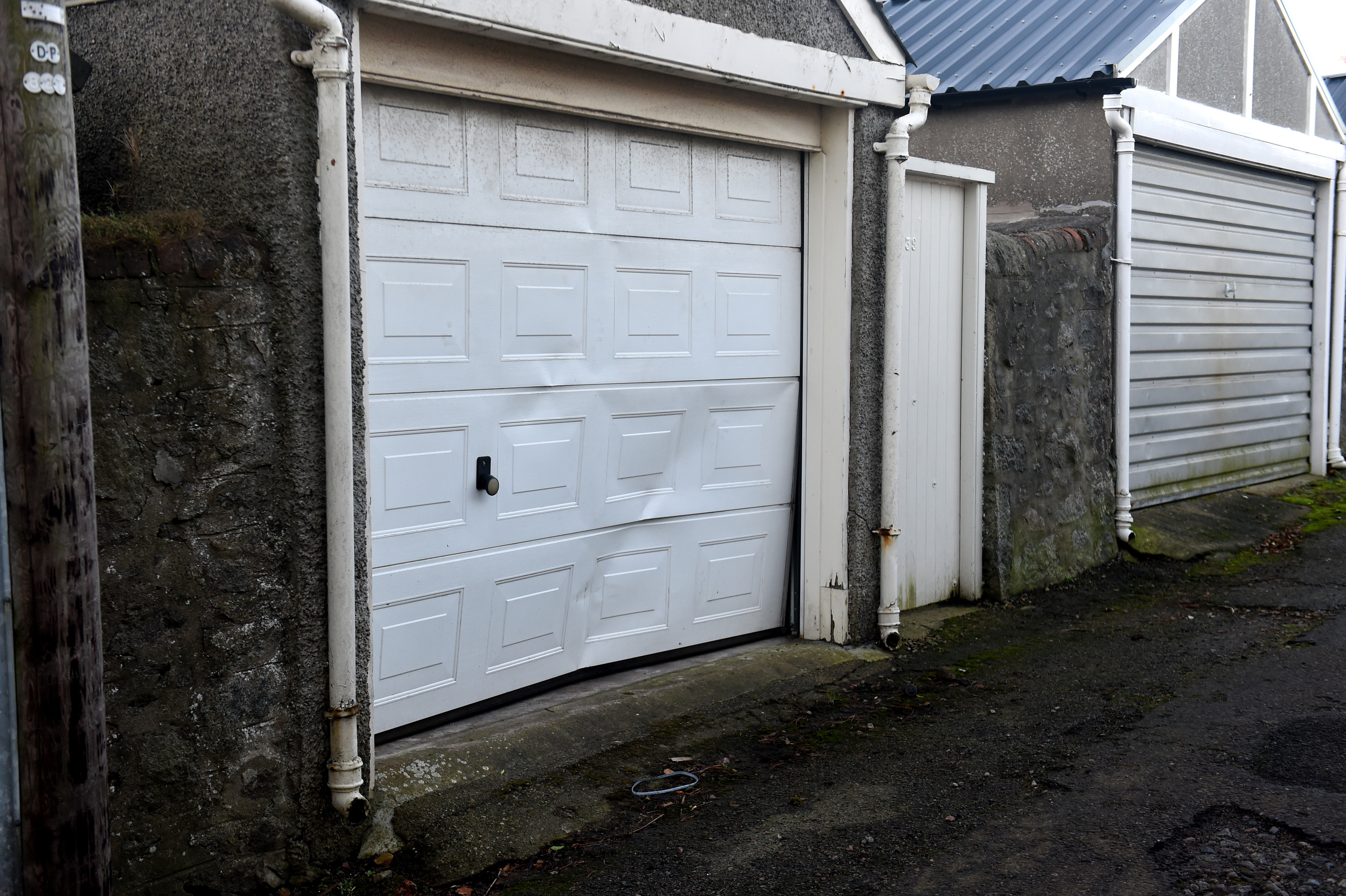 dented:  Damage to a garage near Salisbury Terrace and Gray Street.