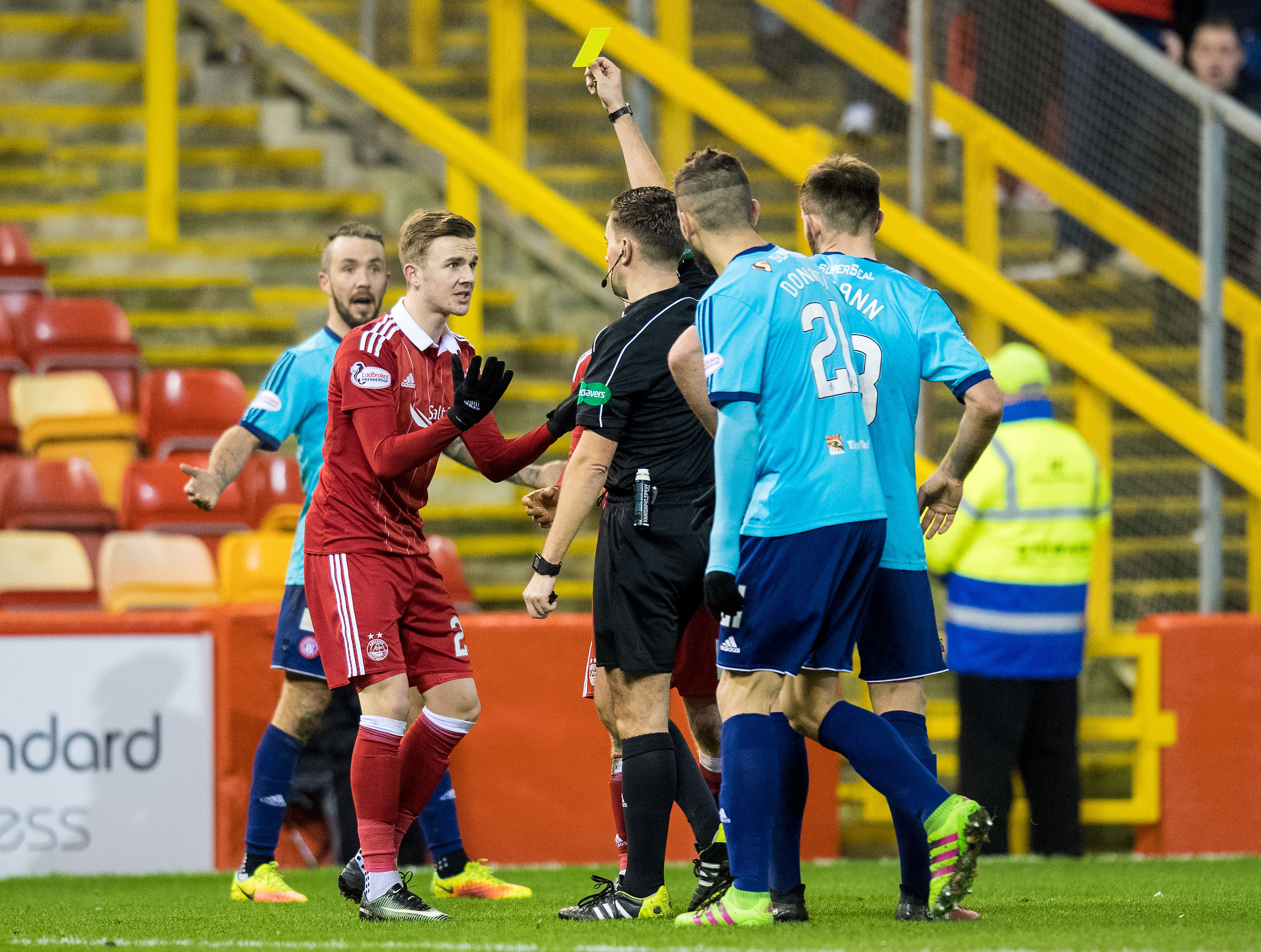 James Maddison is yellow carded by referee Andrew Dallas.