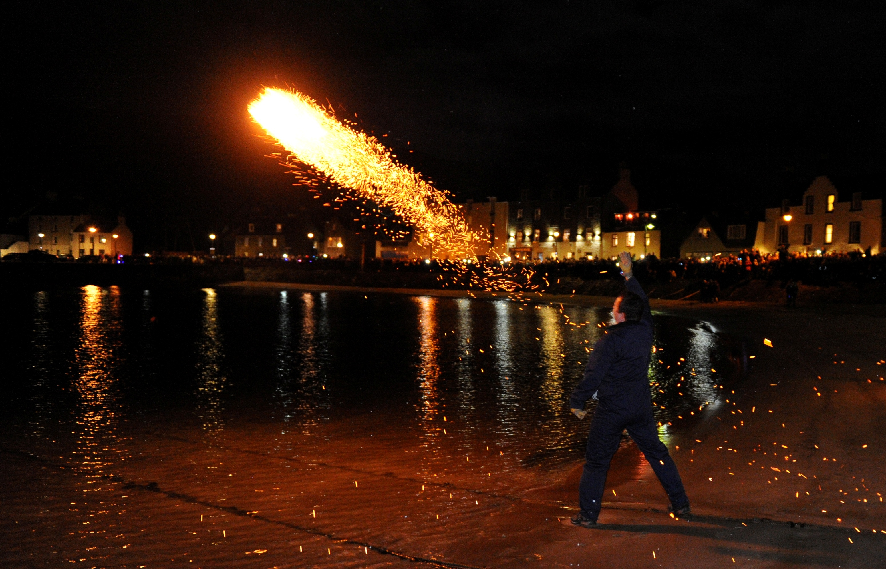 A fireball is launched into the water after the event on Hogmanay 2014.