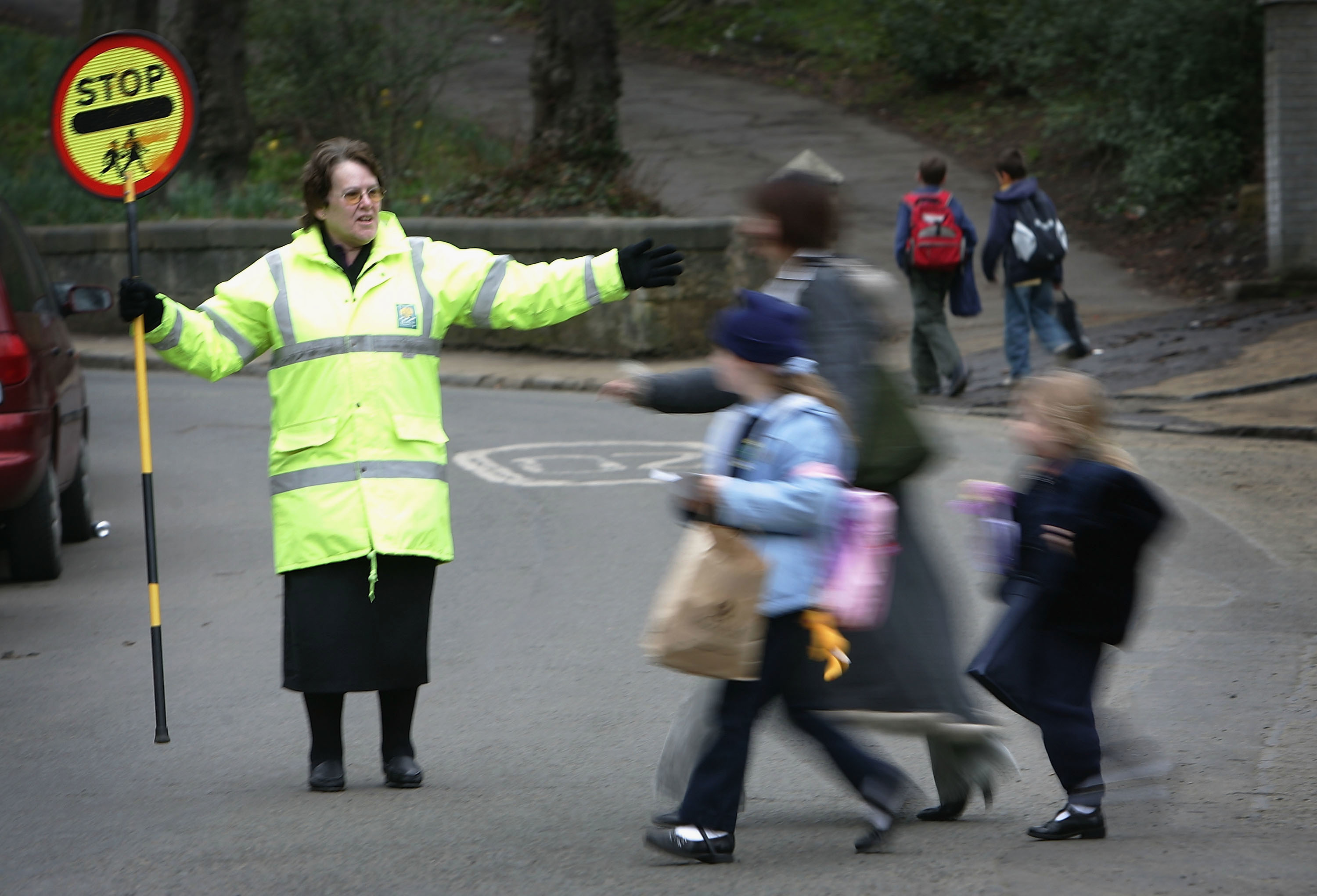 School crossing guards will remain at the same sites.