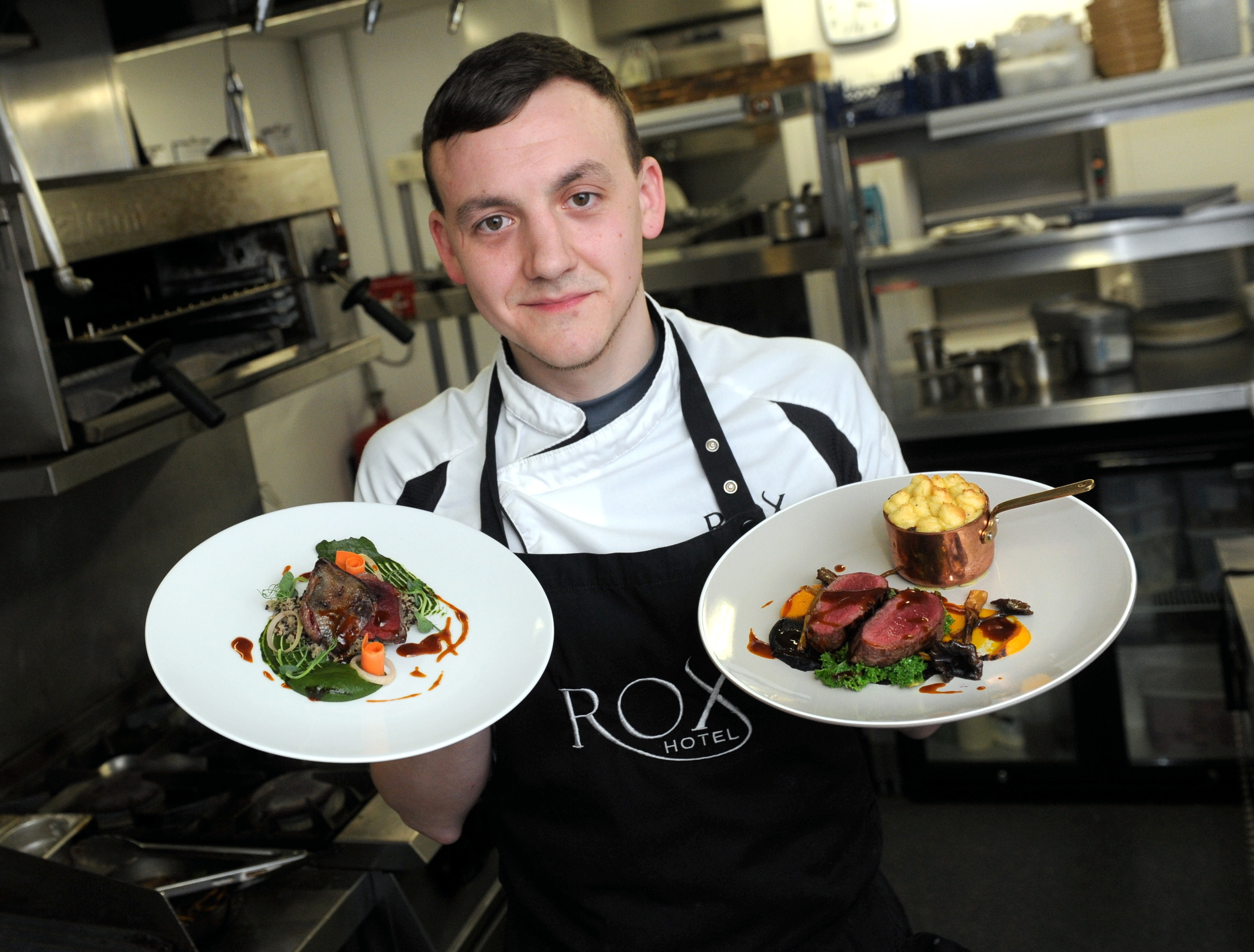 Chef Graham Mitchell with his pigeon and venison dishes.