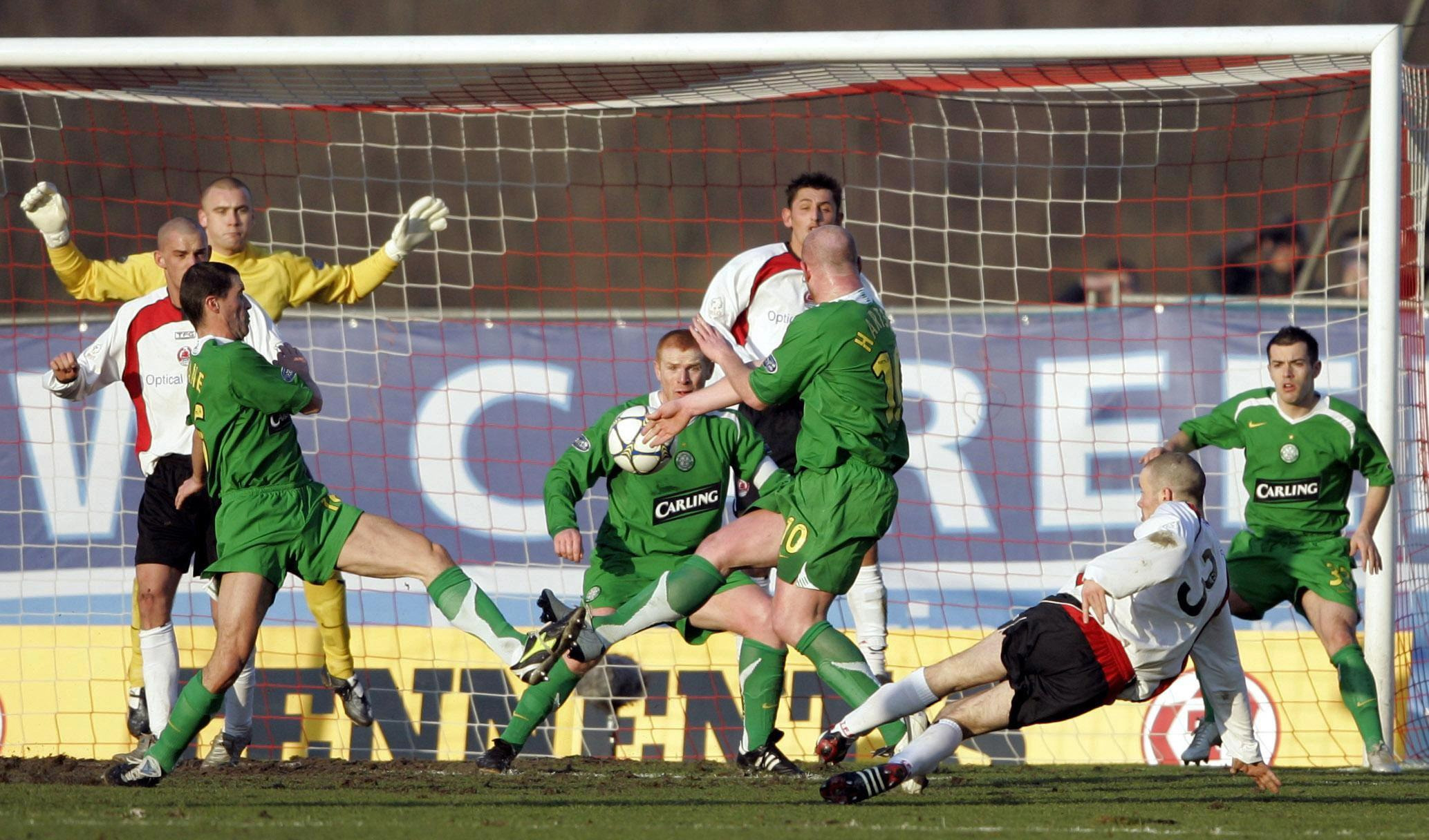 Eddie Malone (No3) scores for Clyde against Celtic.