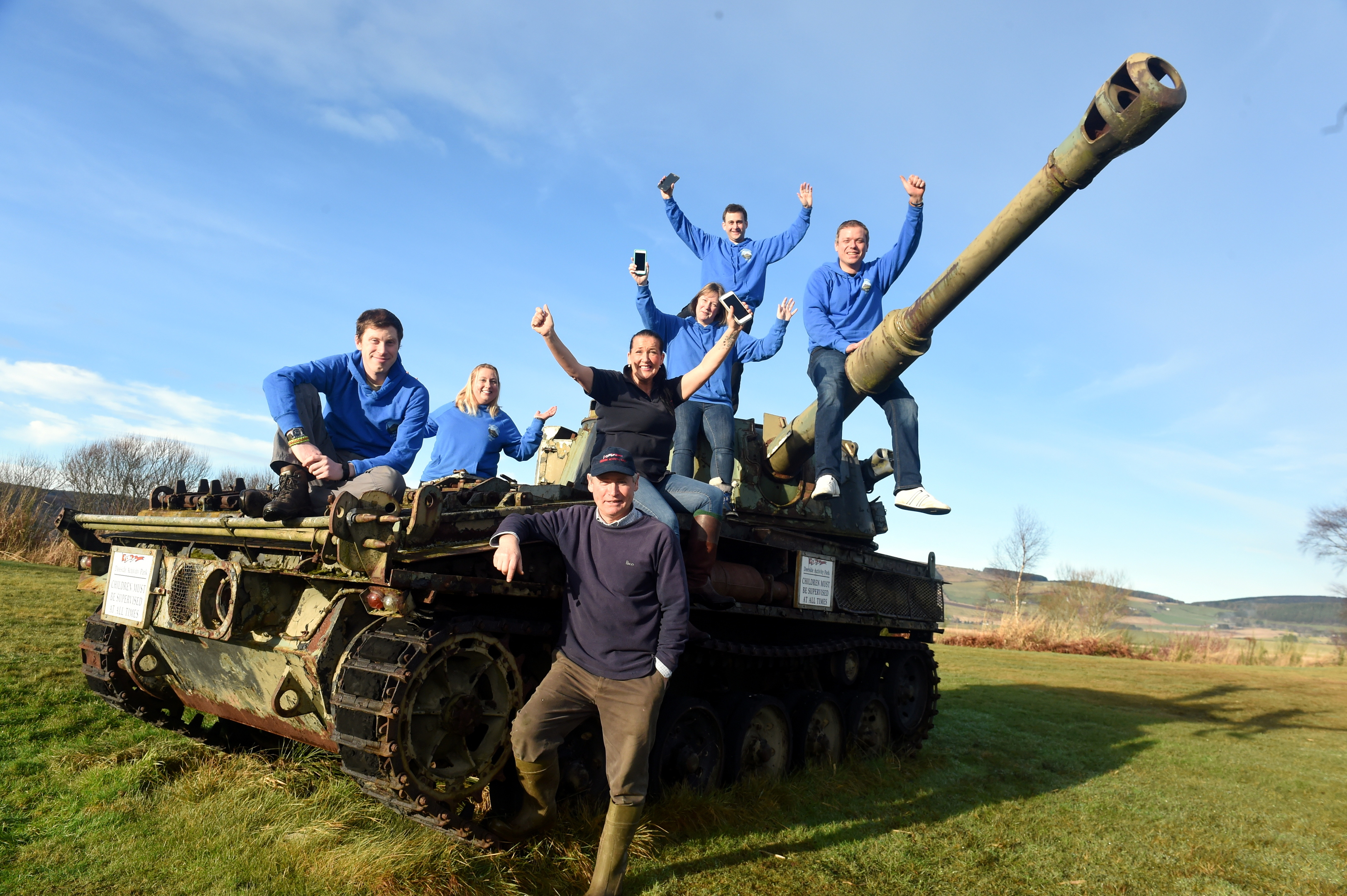 great excitement:  Deeside Activity Park sales and marketing manager Cilla Wood, and park owner, farmer Ken Howie, both in  dark tops, with members of the Mega 2019 committee.