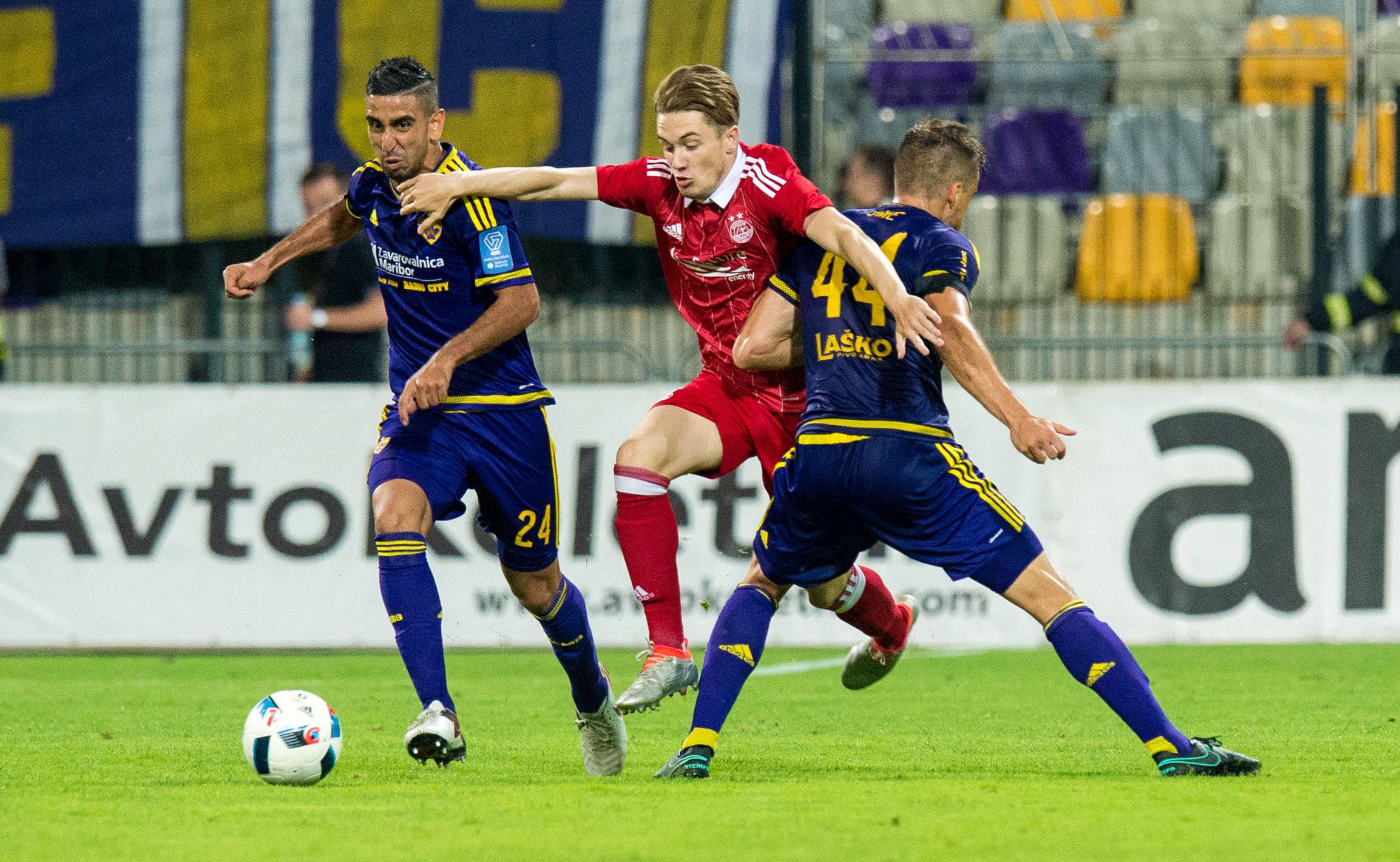 Scott Wright, centre, battles against Maribor earlier this season.