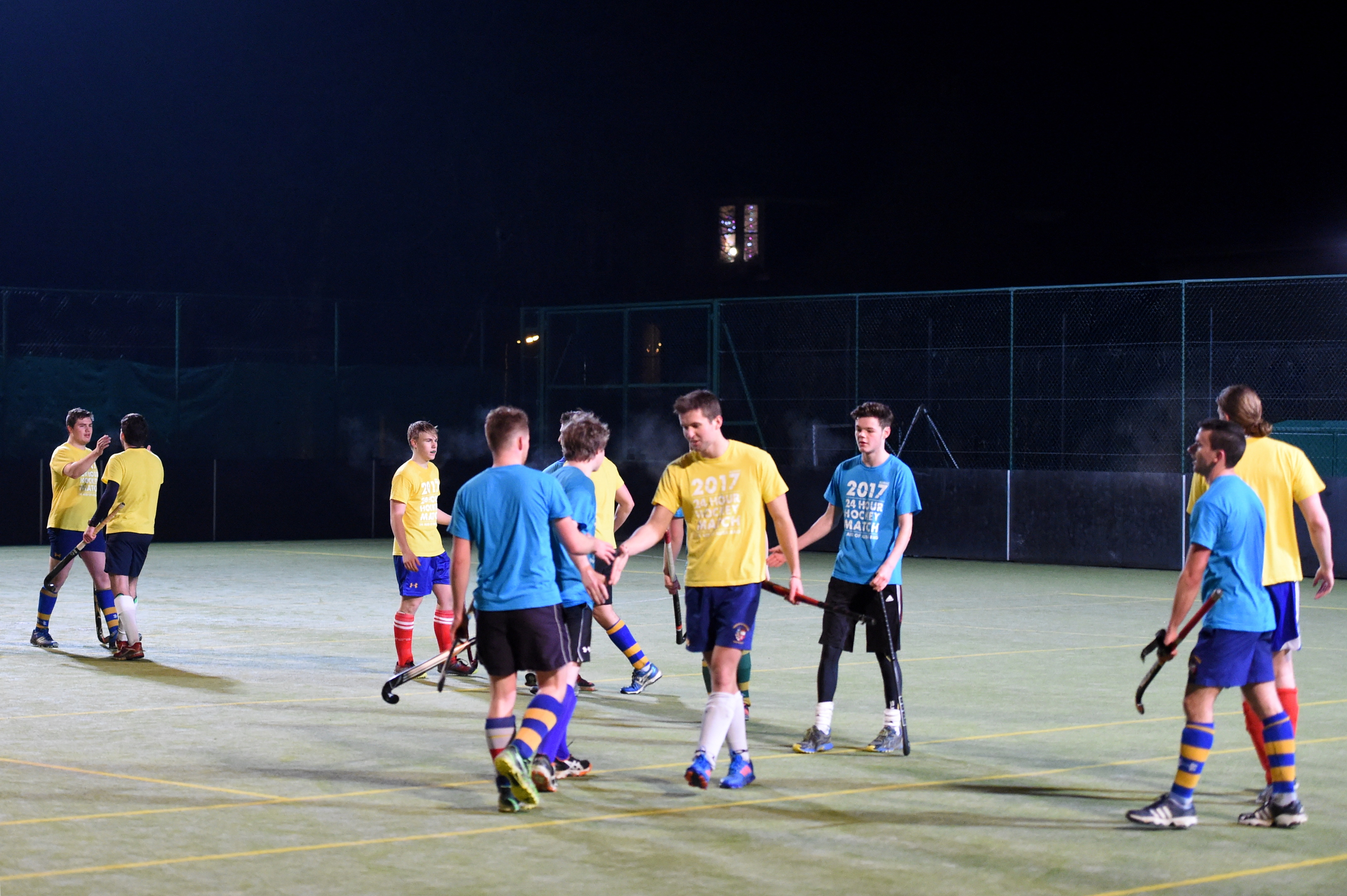 Players shaking hands after the 24-hour match at King's Pavilion.