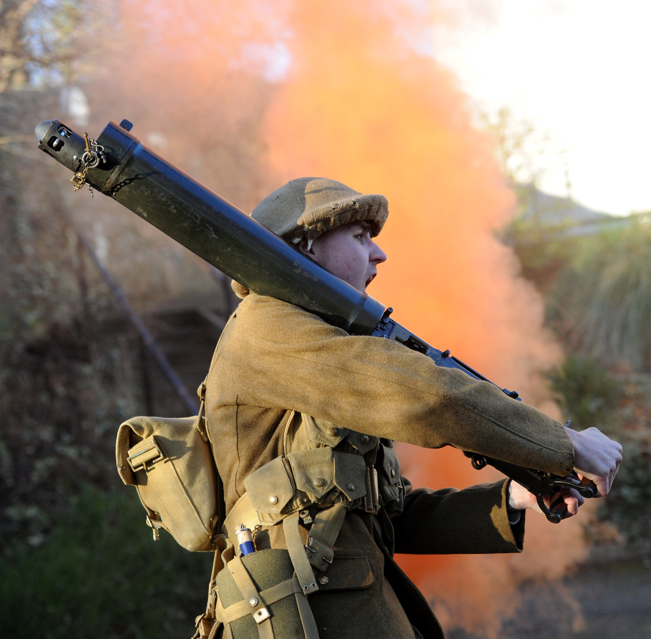 Pte McIntosh carried two light rifles from the German embankment after storming it.