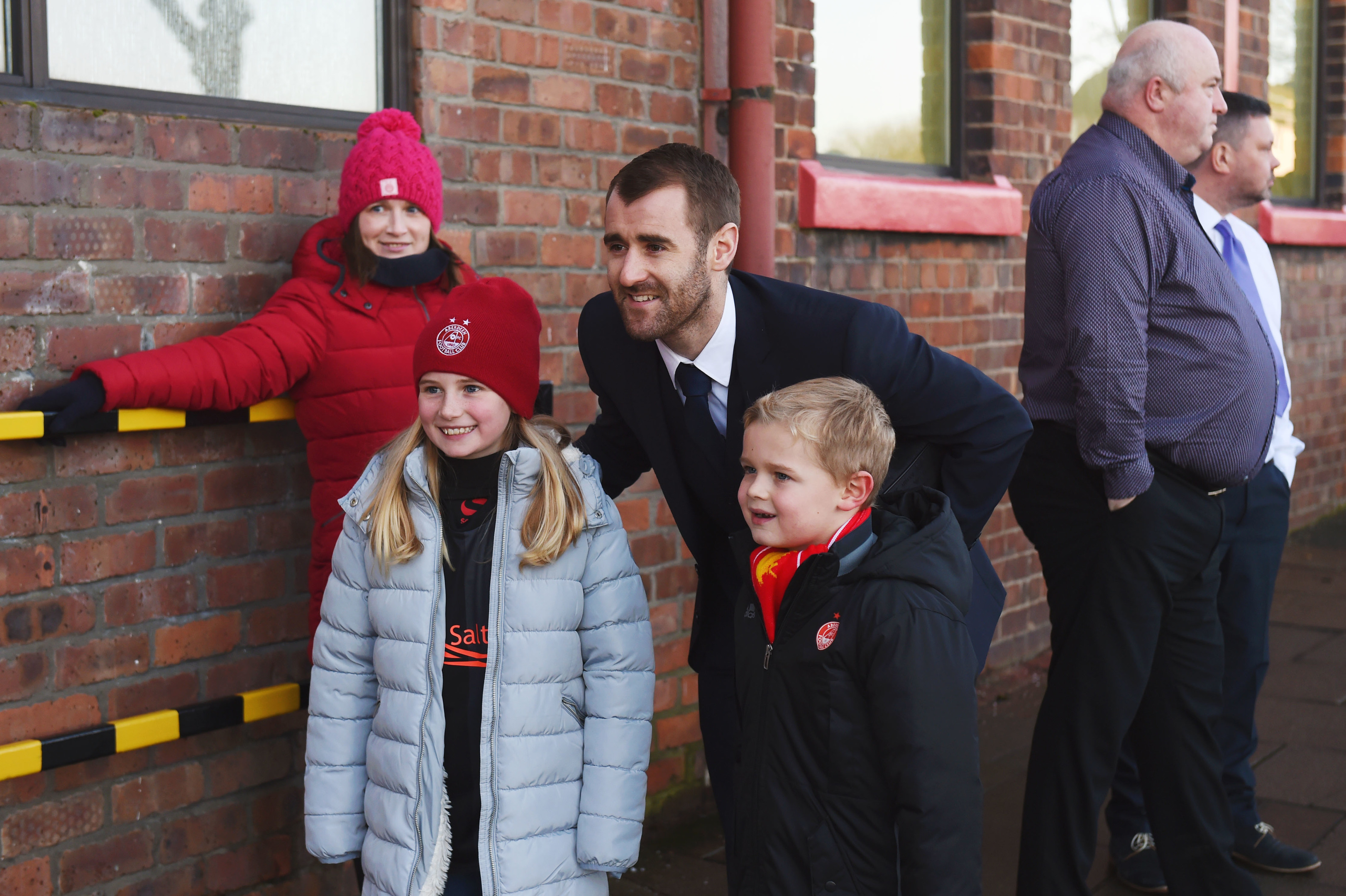 Niall McGinn meets some  fans outside Pittodrie.