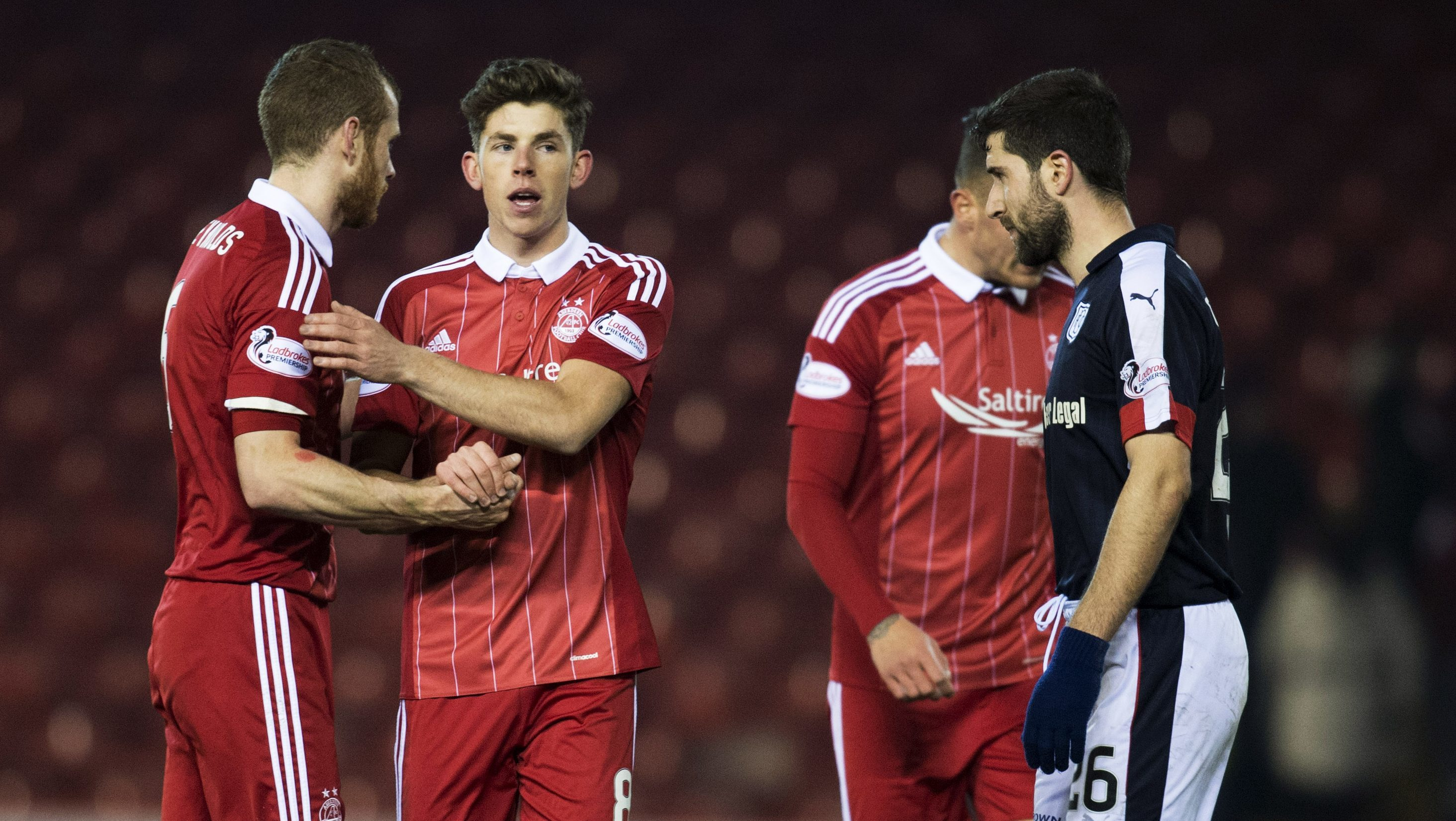 Mark Reynolds congratulates Ryan Christie after the victory over Dundee.