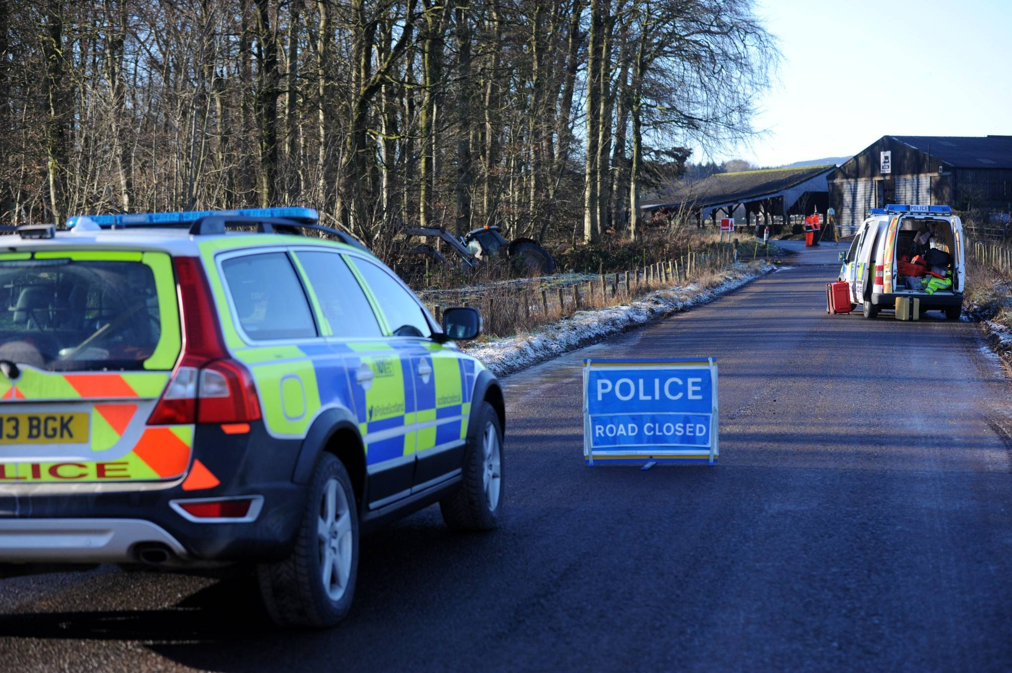 Police at the scene of the tractor crash on Glenbervie Road, between Drumlithie and Glenbervie.