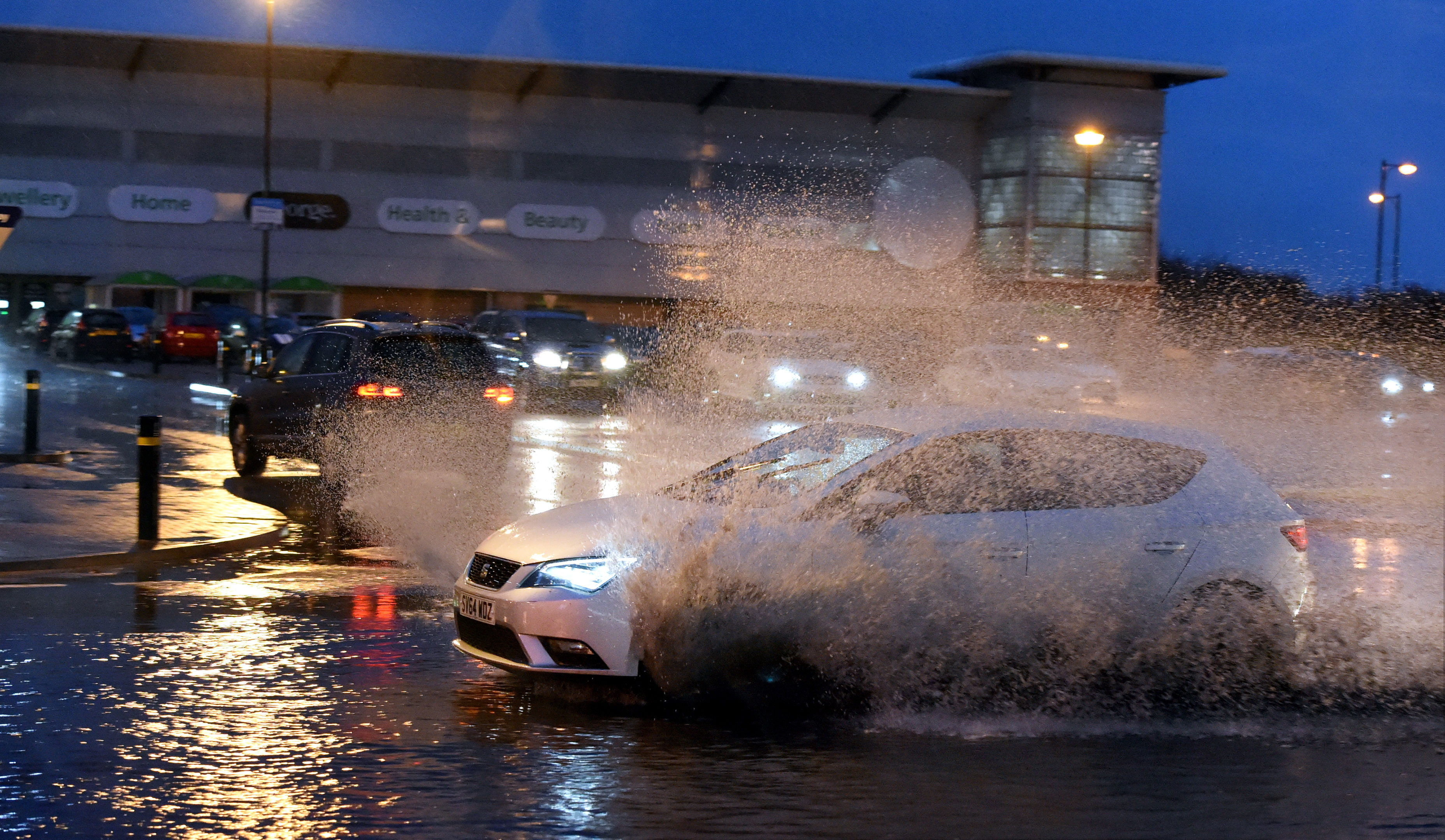 Torrential rain caused flooding at the shopping complex at the beach.