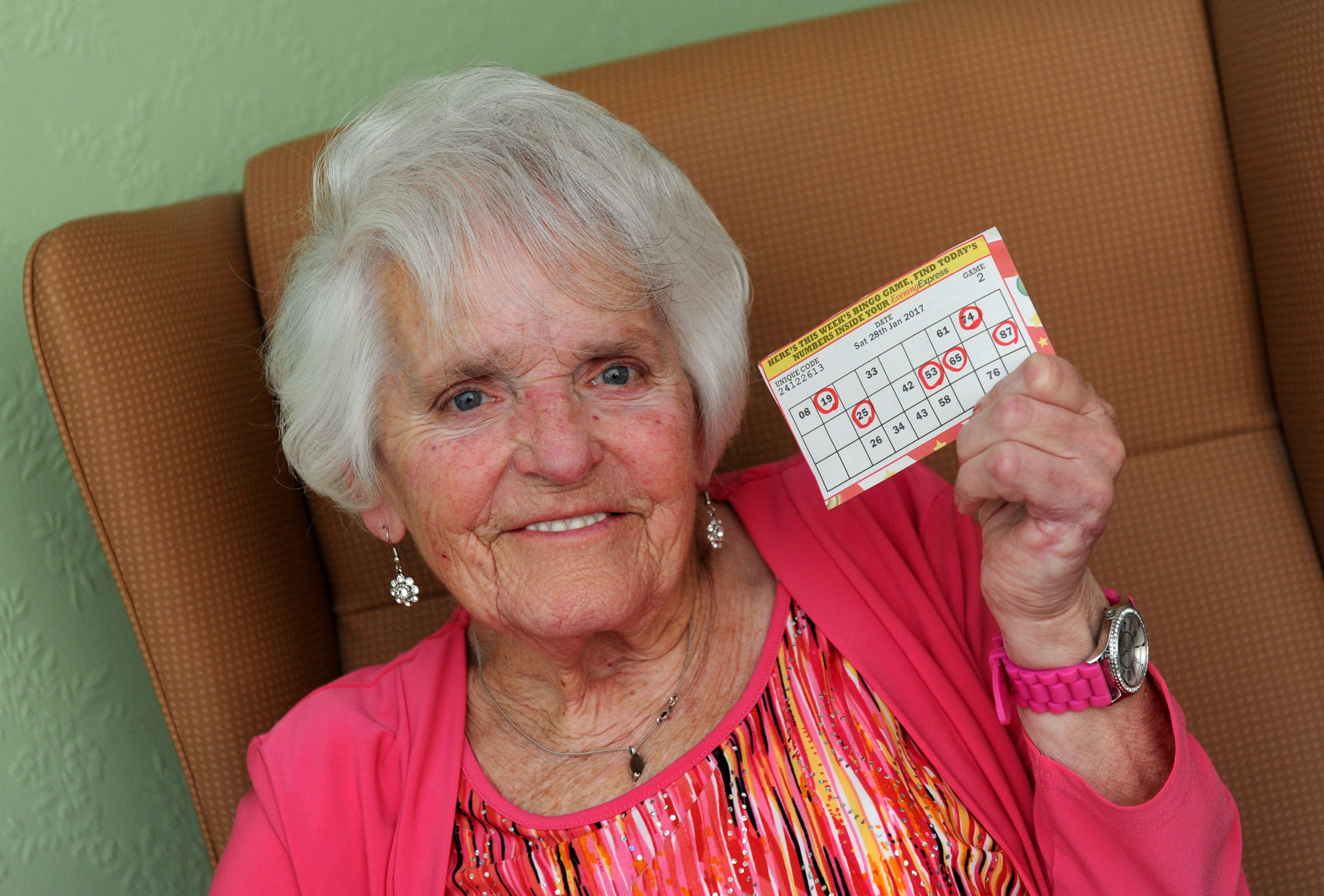 Mary McKenzie holds  on tight to her lucky bingo ticket.