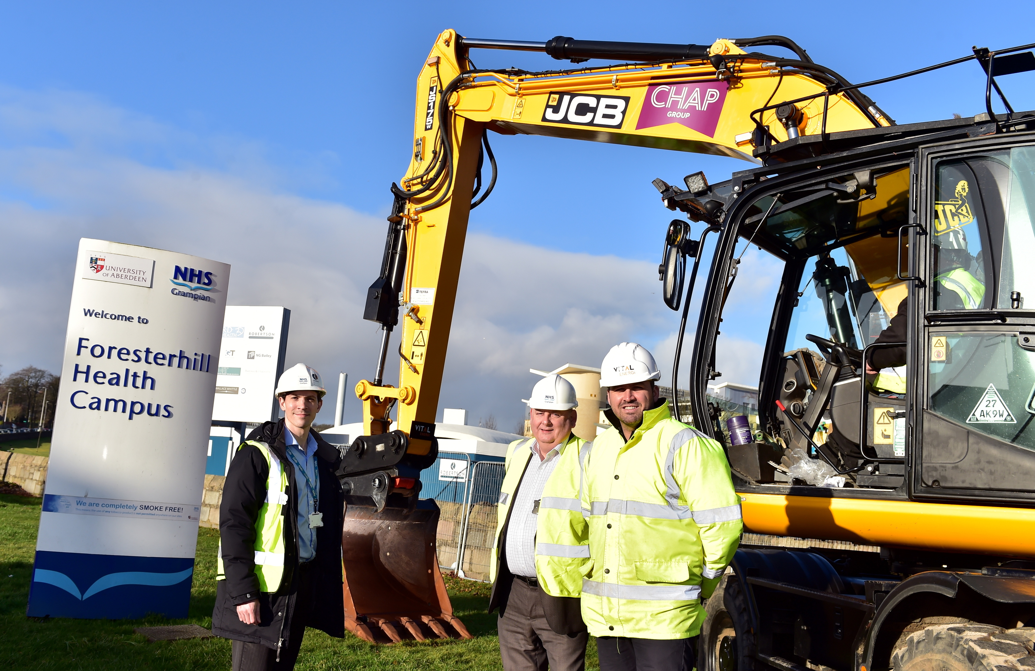 From left, Robert Hobkirk and Graham Mutch of the  NHS and Daniel Glynn of Vital Energy.