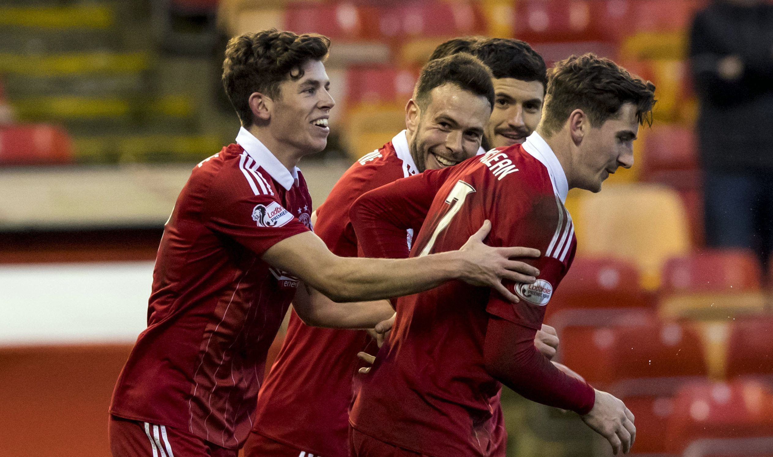 Aberdeen scorer Ryan Christie, left, celebrates with Andy Considine, Anthony O'Connor and Kenny McLean after his goal against Partick Thistle at Pittodrie.