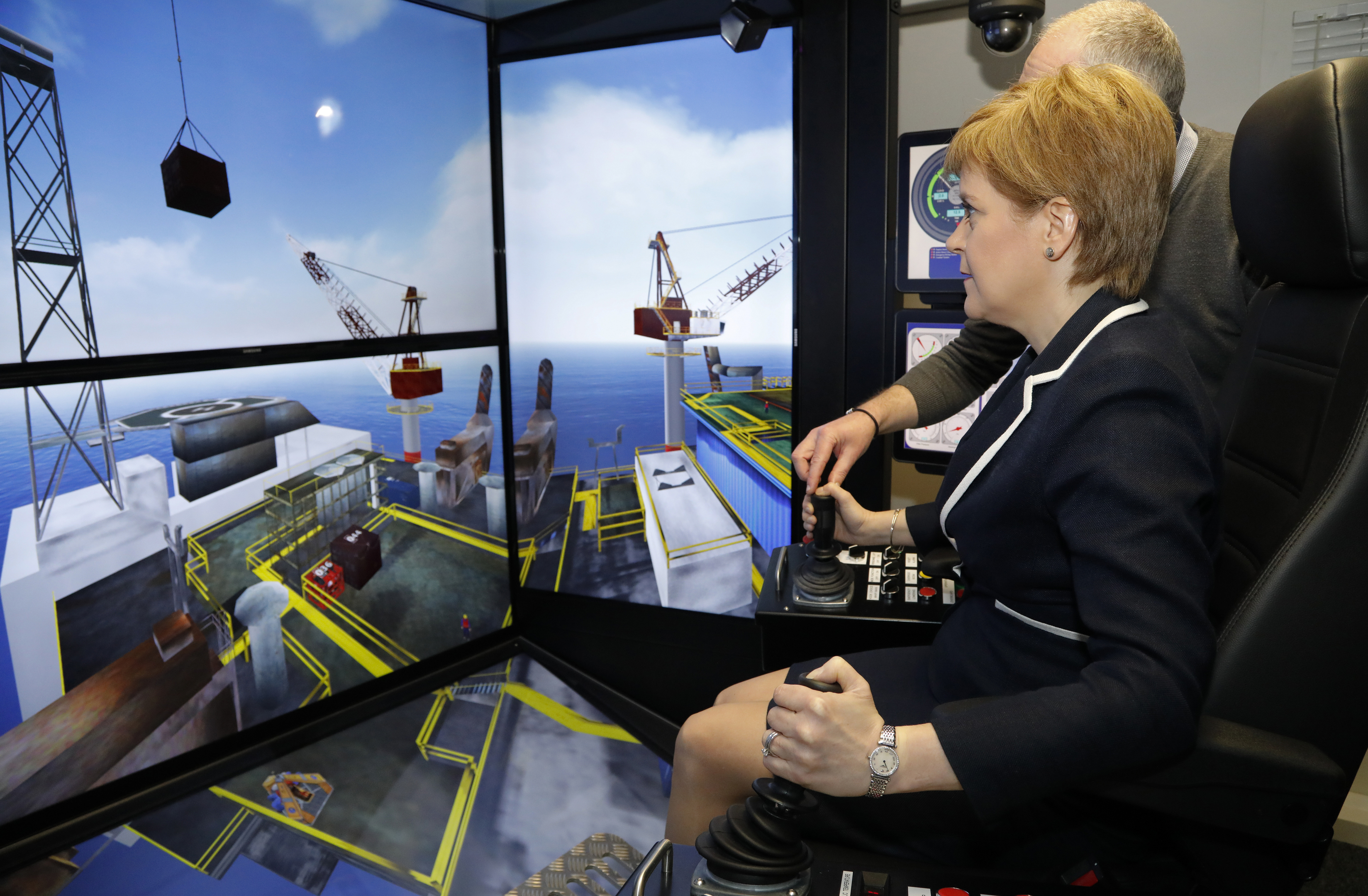 First Minister Sturgeon tries out a simulator.