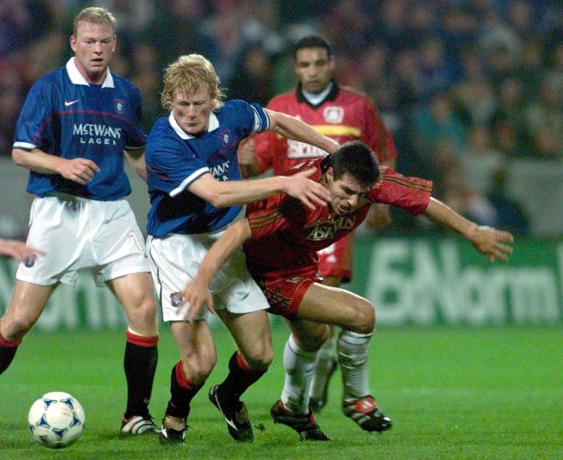 Colin Hendry, centre, in action for Rangers against Bayer Leverkusen in 1998.