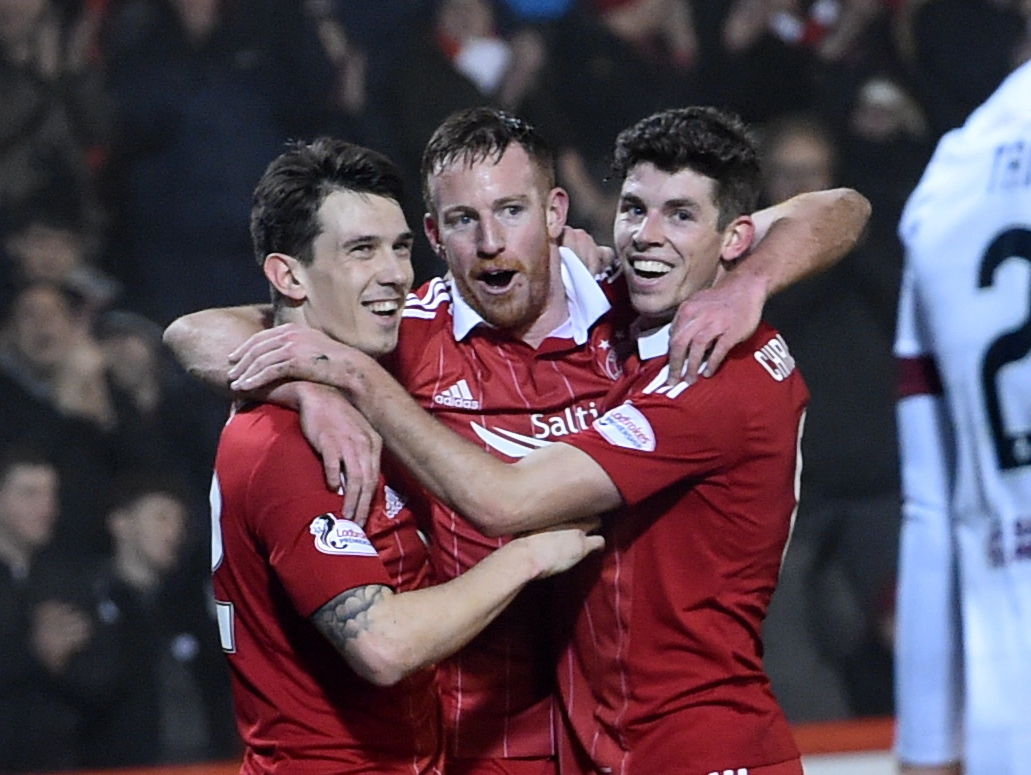 Ryan Christie, right, celebrates with  Ryan Jack, left, and Adam Rooney. (Picture by Darrell Benns.)