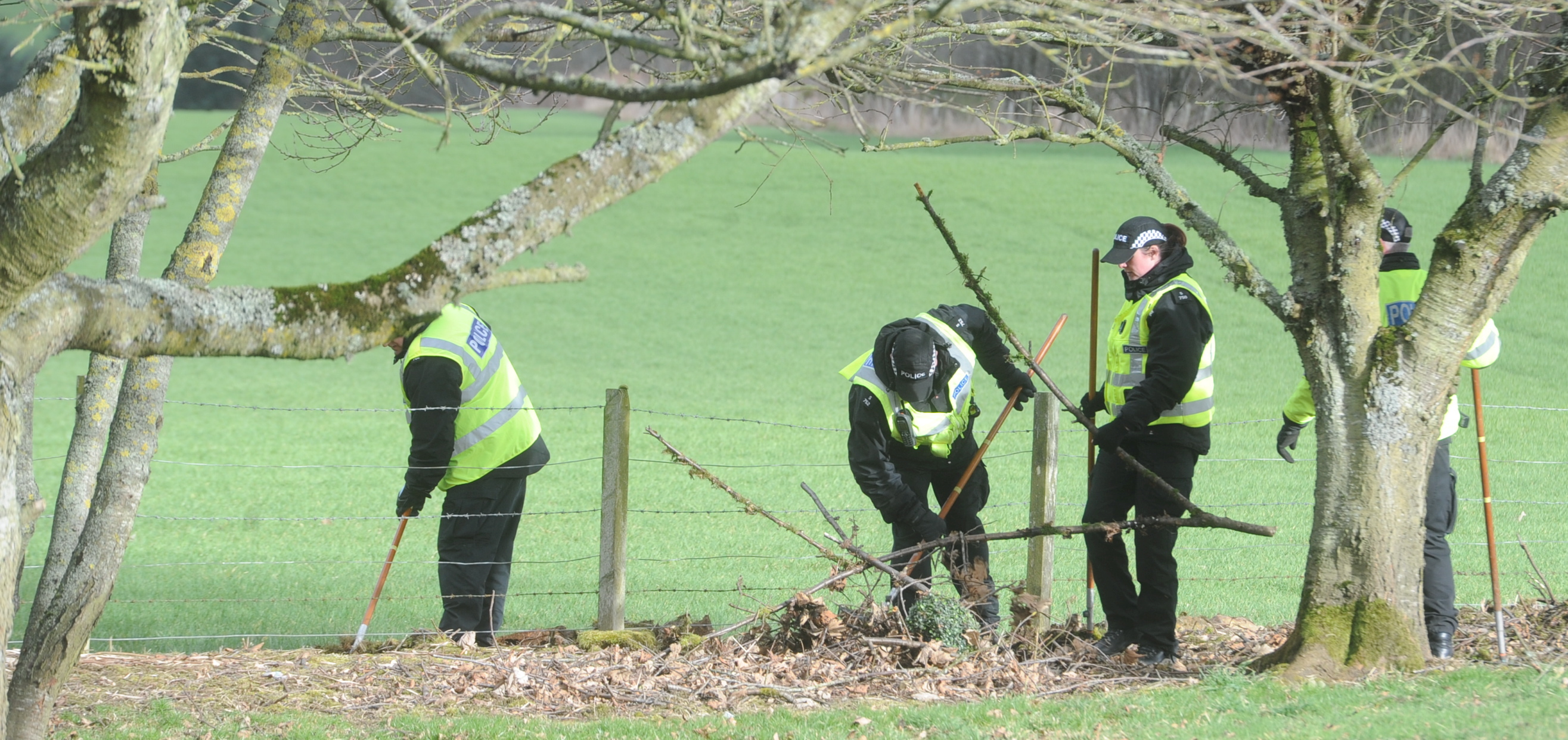 Officers from Police Scotland search an area close to Rothienorman.