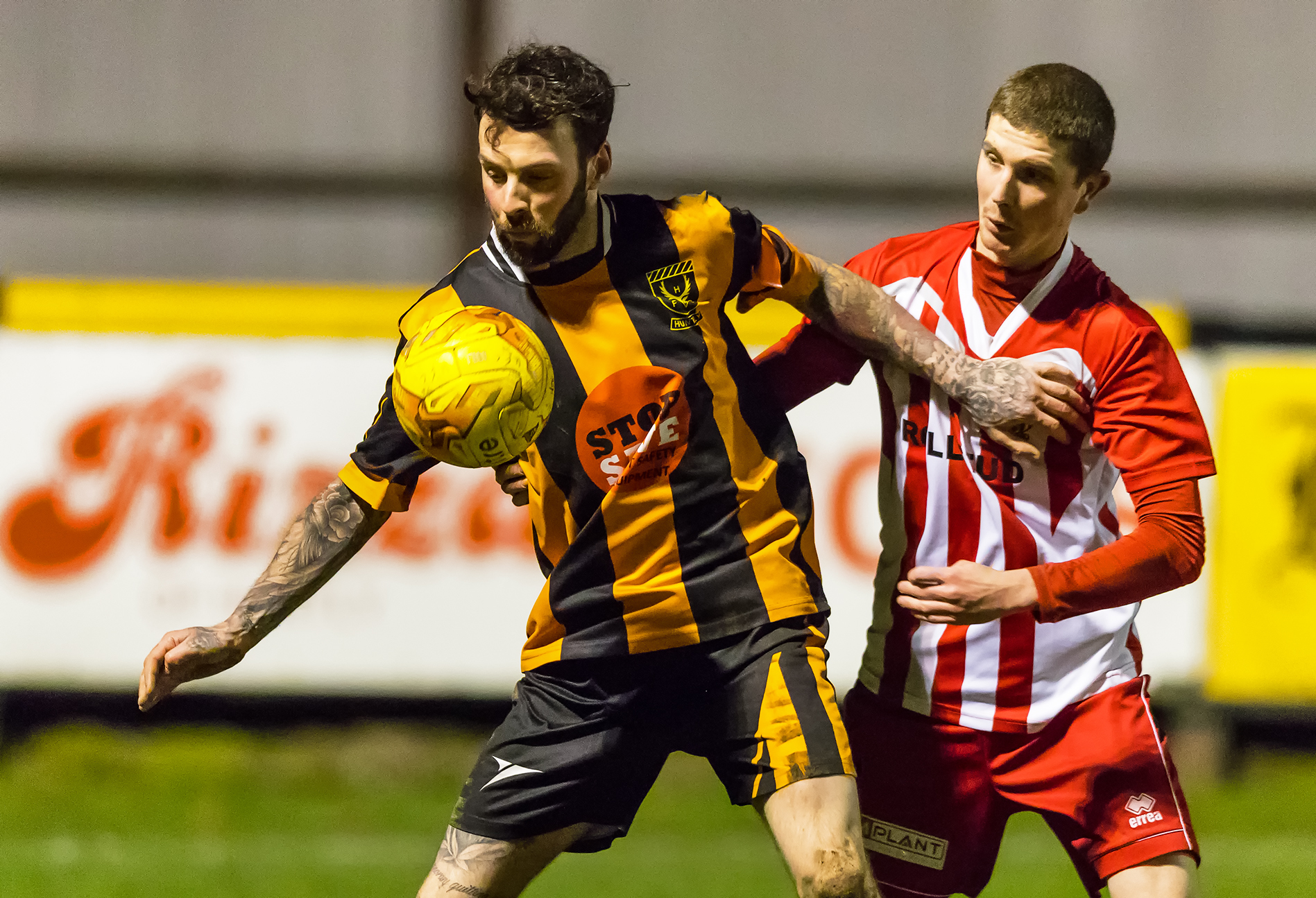 Huntly's Gary McGowan shields the ball during the 3-3 draw against Formartine United.