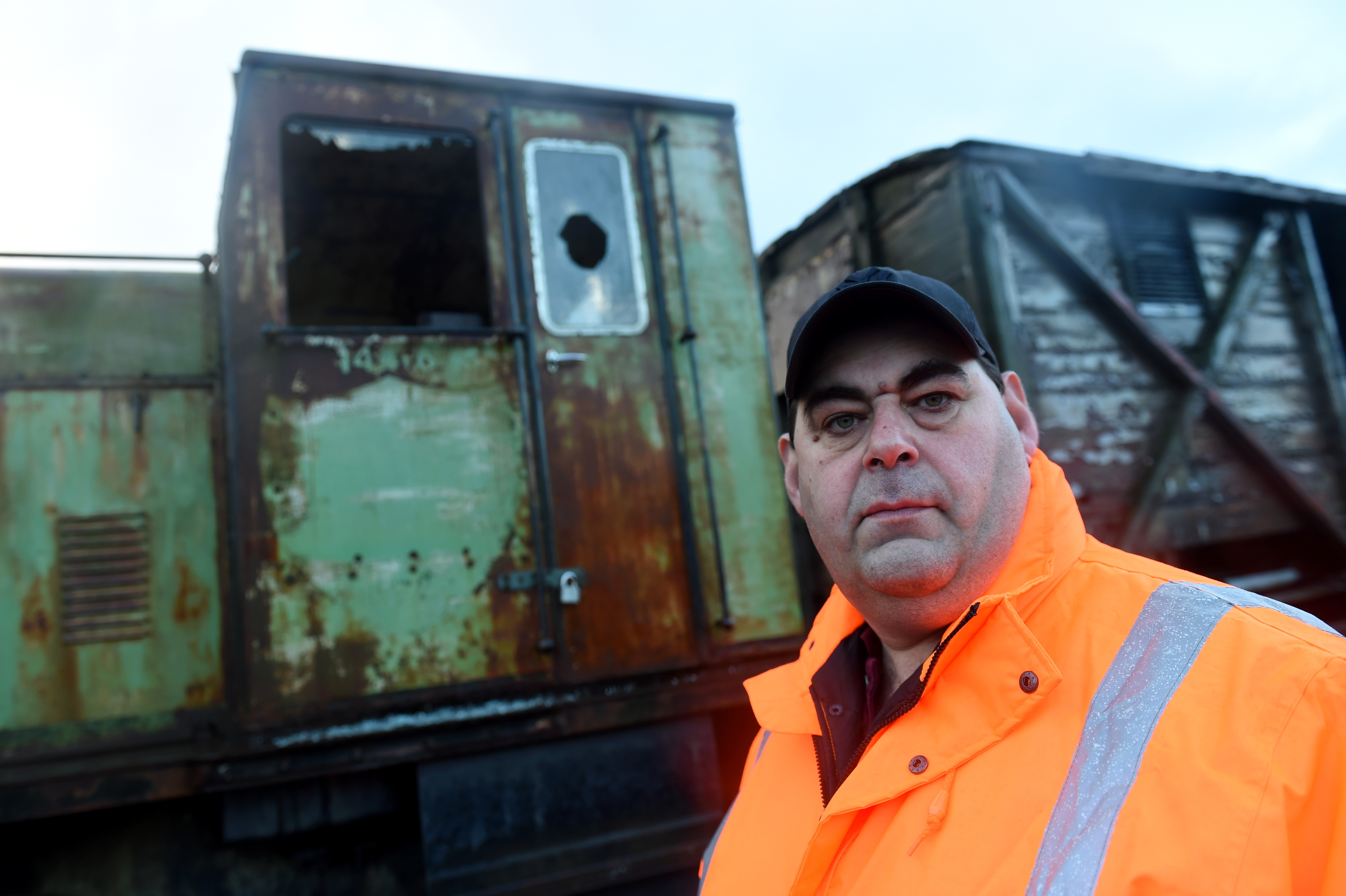 destruction:  Gary Thorley-Smith with one of the damaged engines and, inset, the dummy camera.   pictures by darrell benns