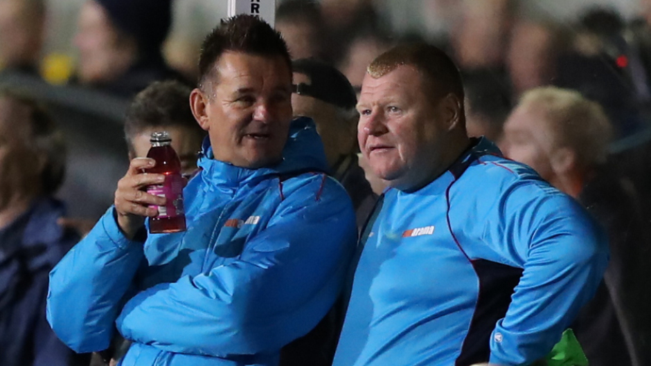 Wayne Shaw, right, speaking to manager Paul Doswell.
