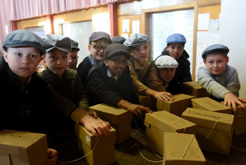 Pictured are pupils from Kingsford School, Mastrick, Aberdeen picking up their mock gas masks as part of a re-enactment of the World War 2 evacuations. The pupils left the school and took an old style bus to the train station where they then got the train to Stonehaven. Picture by DARRELL BENNS  Pictured on 27/03/2017