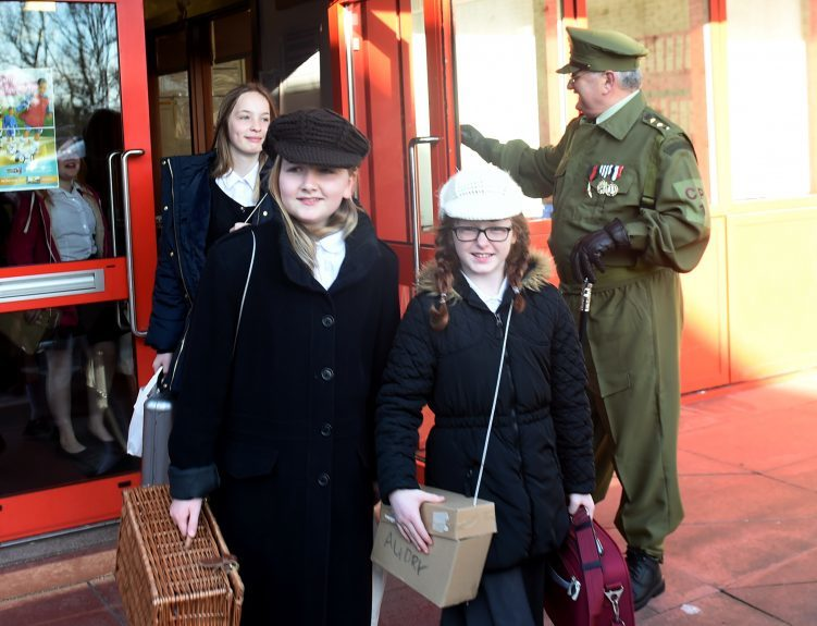 Pictured are pupils from Kingsford School, Mastrick, Aberdeen leaving the school as part of a re-enactment of the World War 2 evacuations. The pupils left the school and took an old style bus to the train station where they then got the train to Stonehaven. Picture by DARRELL BENNS  Pictured on 27/03/2017