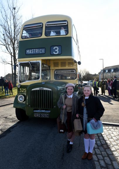 Pictured are pupils from Kingsford School, Mastrick, Aberdeen with the old style bus as part of a re-enactment of the World War 2 evacuations. The pupils left the school and took an old style bus to the train station where they then got the train to Stonehaven. Picture by DARRELL BENNS  Pictured on 27/03/2017
