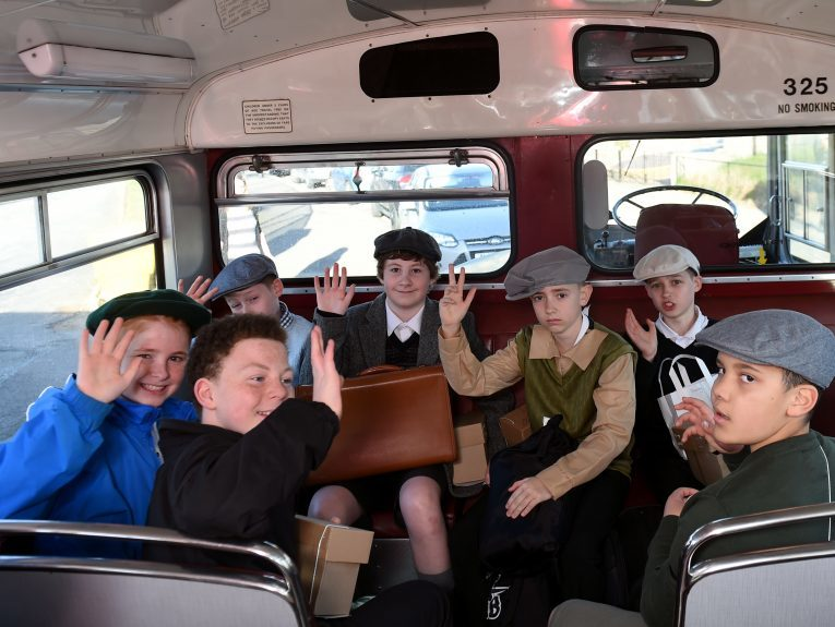 Pictured are pupils from Kingsford School, Mastrick, Aberdeen on the old style bus as part of a re-enactment of the World War 2 evacuations. The pupils left the school and took an old style bus to the train station where they then got the train to Stonehaven. Picture by DARRELL BENNS  Pictured on 27/03/2017