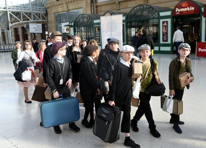 Pictured are pupils from Kingsford School, Mastrick, Aberdeen at Aberdeen Train Station as part of a re-enactment of the World War 2 evacuations. The pupils left the school and took an old style bus to the train station where they then got the train to Stonehaven. Picture by DARRELL BENNS  Pictured on 27/03/2017