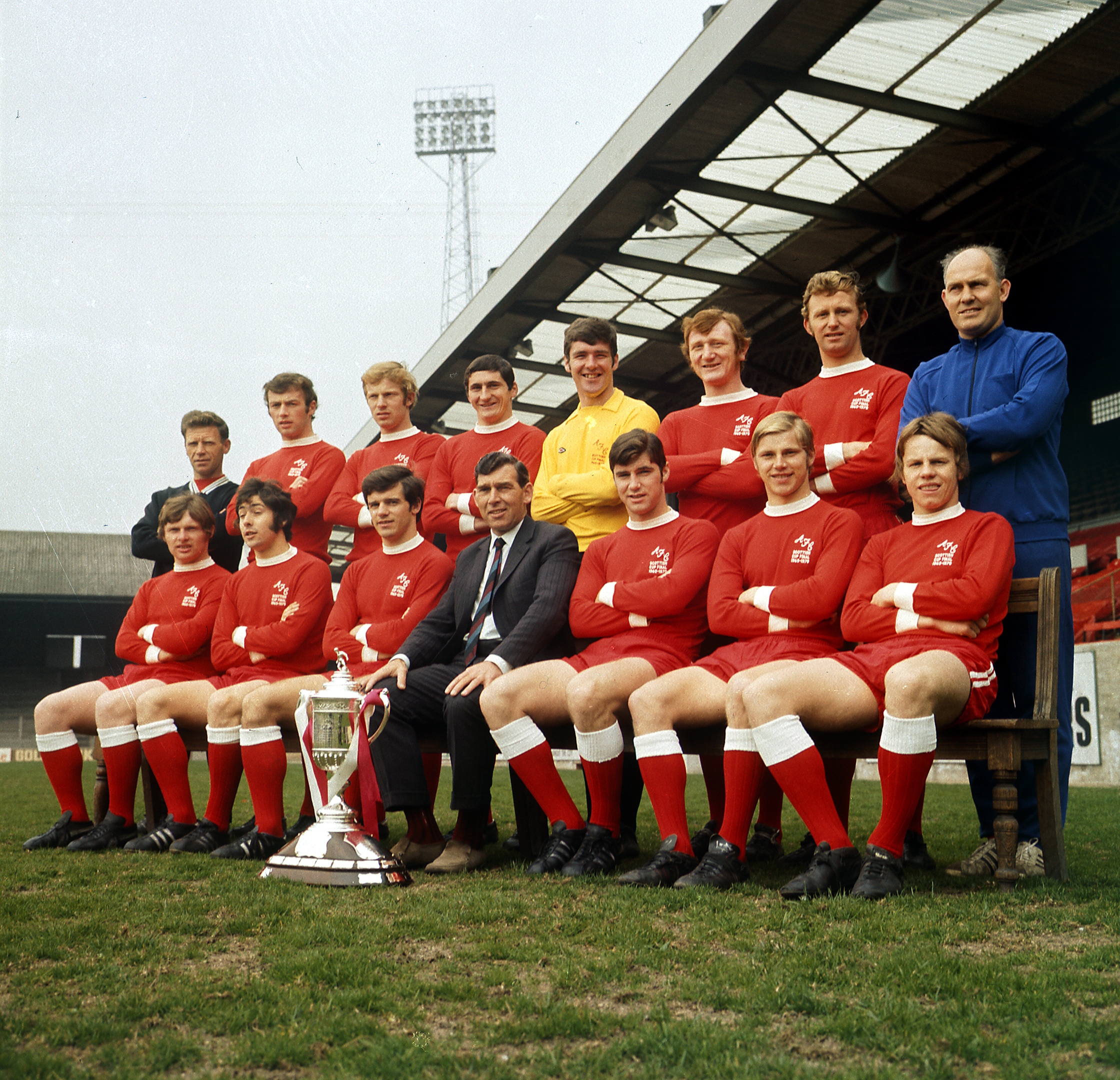 Aberdeen with the Scottish Cup in 1970. Back, from left, Teddy Scott (trainer), Tommy McMillan, Henning Boel, Jim Hermiston, Bobby Clark, Davie Robb, George Murray, Jimmy Bonthrone (assistant manager). Front,  Joe Harper, Derek McKay, Jim Forrest, Eddie Turnbull (manager), Martin Buchan (captain), George Buchan and Arthur Graham.