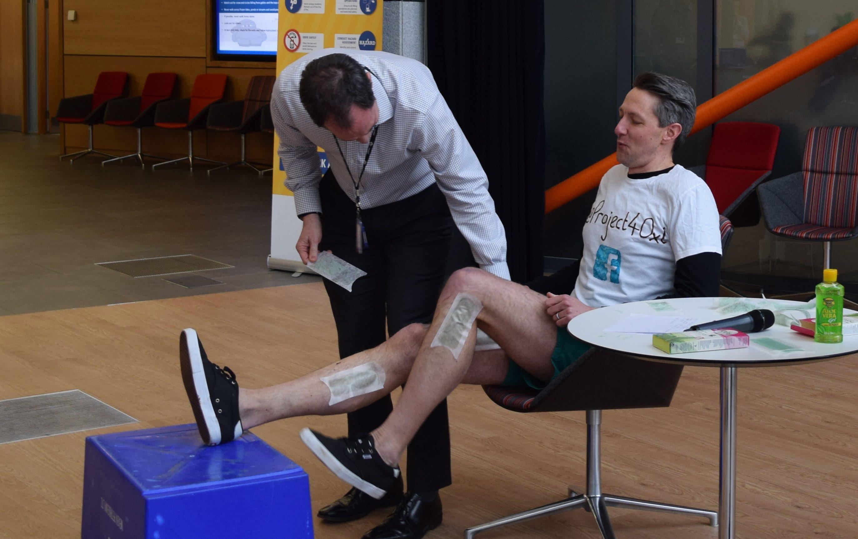 Robbie having his legs waxed.