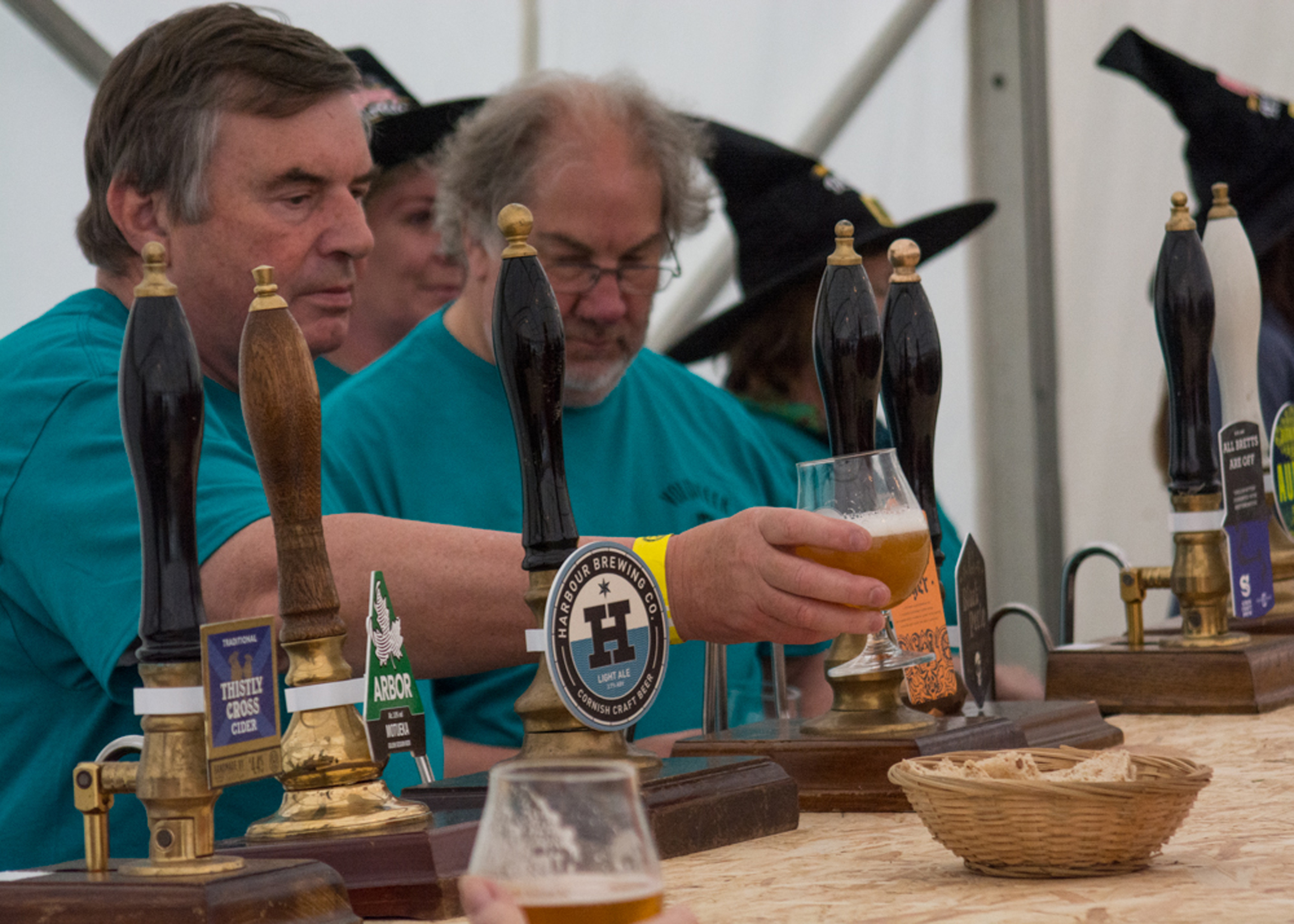 Volunteers pulling pints. Picture by Barry Howie