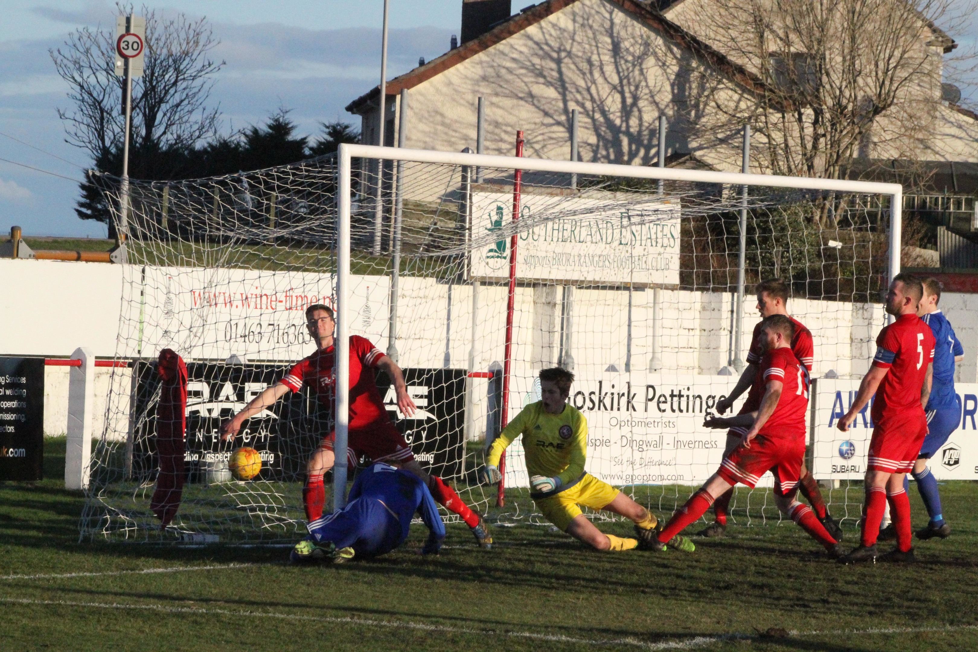 IT'S THERE:  Jason Brown  scores Cove's winning goal.