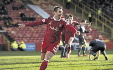 Dons attacker Niall McGinn celebrates his late goal against Motherwell.
