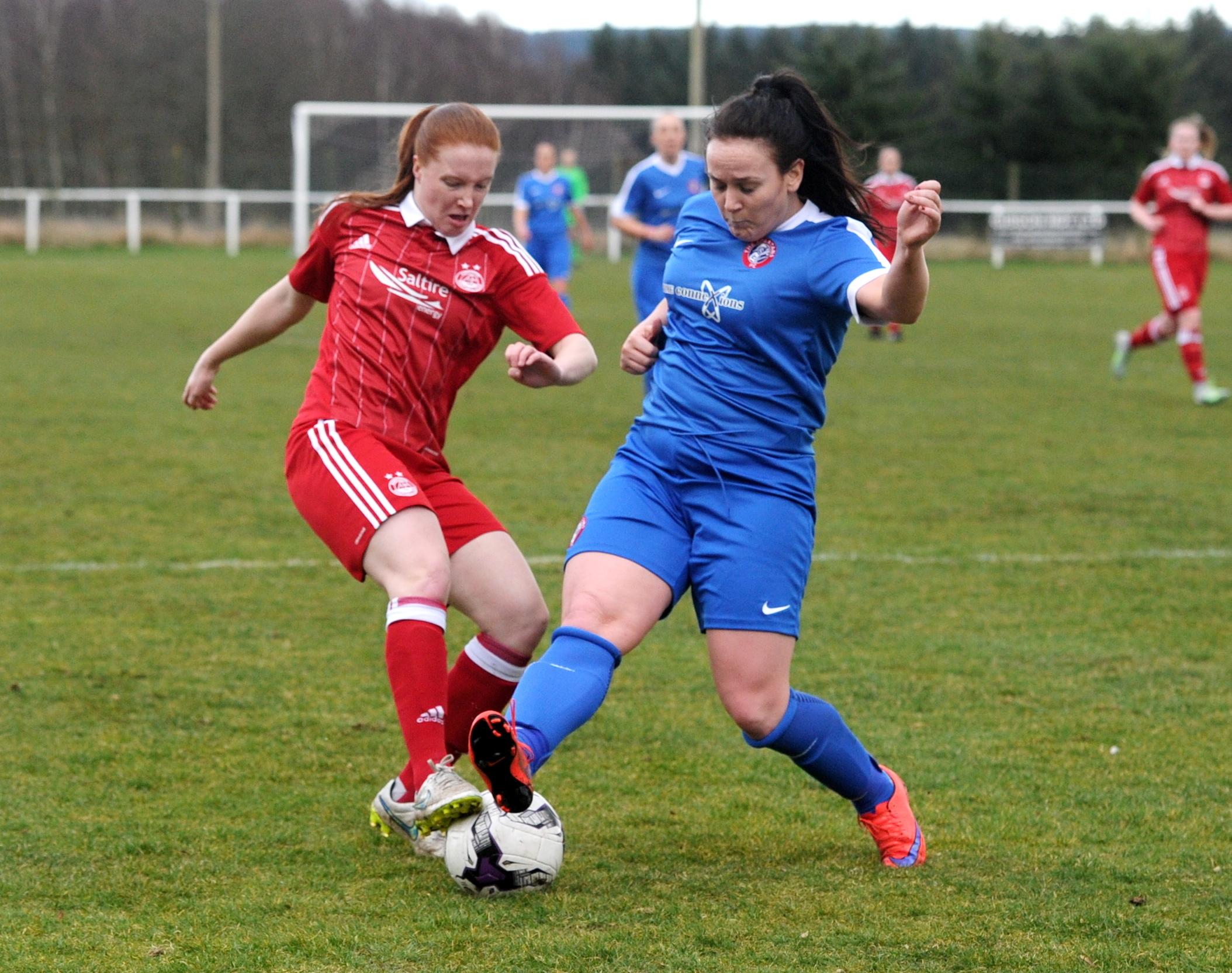 Aberdeen's Hannah Stewart, left,  and Spartans' Bobbie Beveridge.