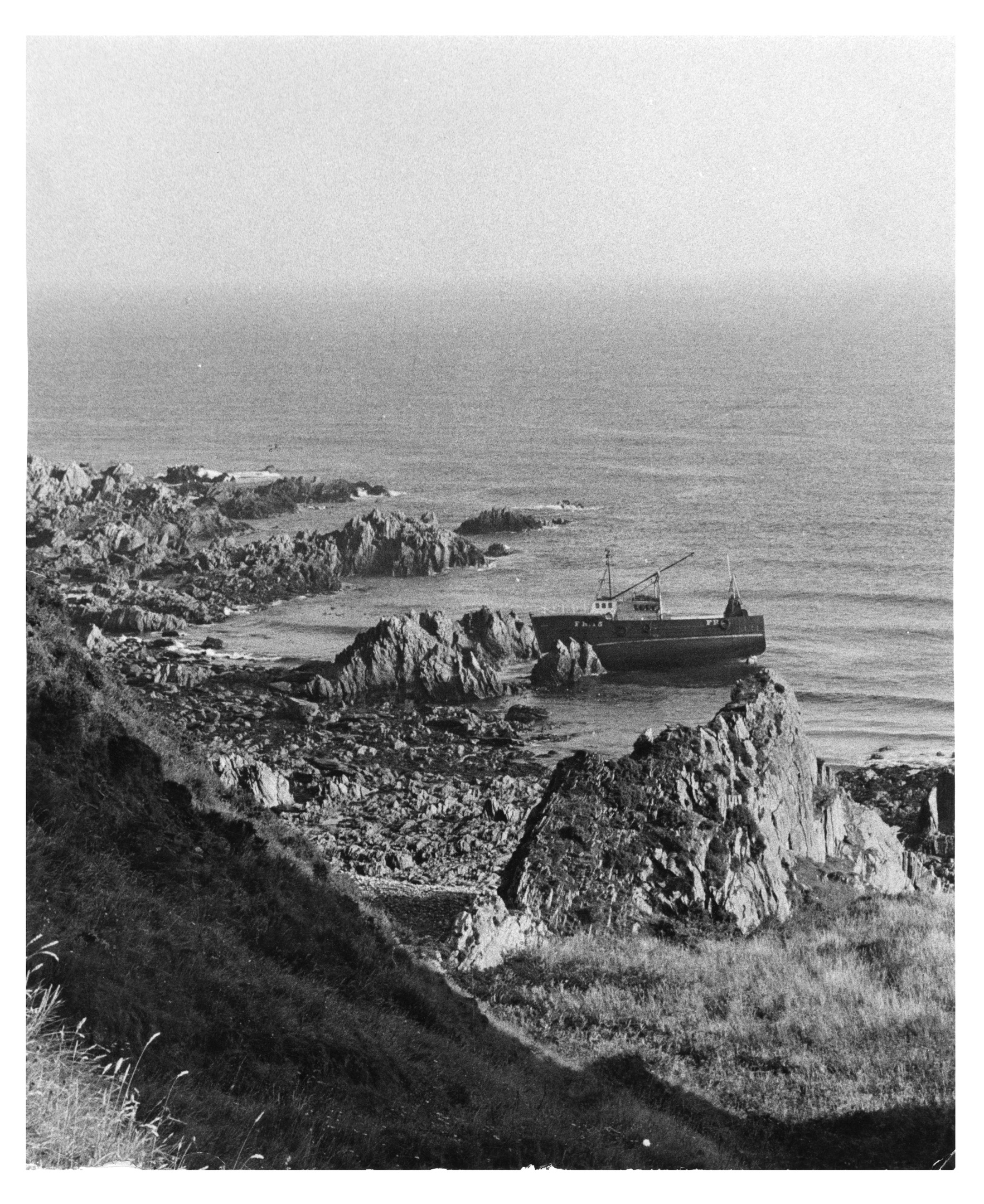 Fraserburgh fishing boat Artemis on rocks between Logie Head and Findlater Castle.