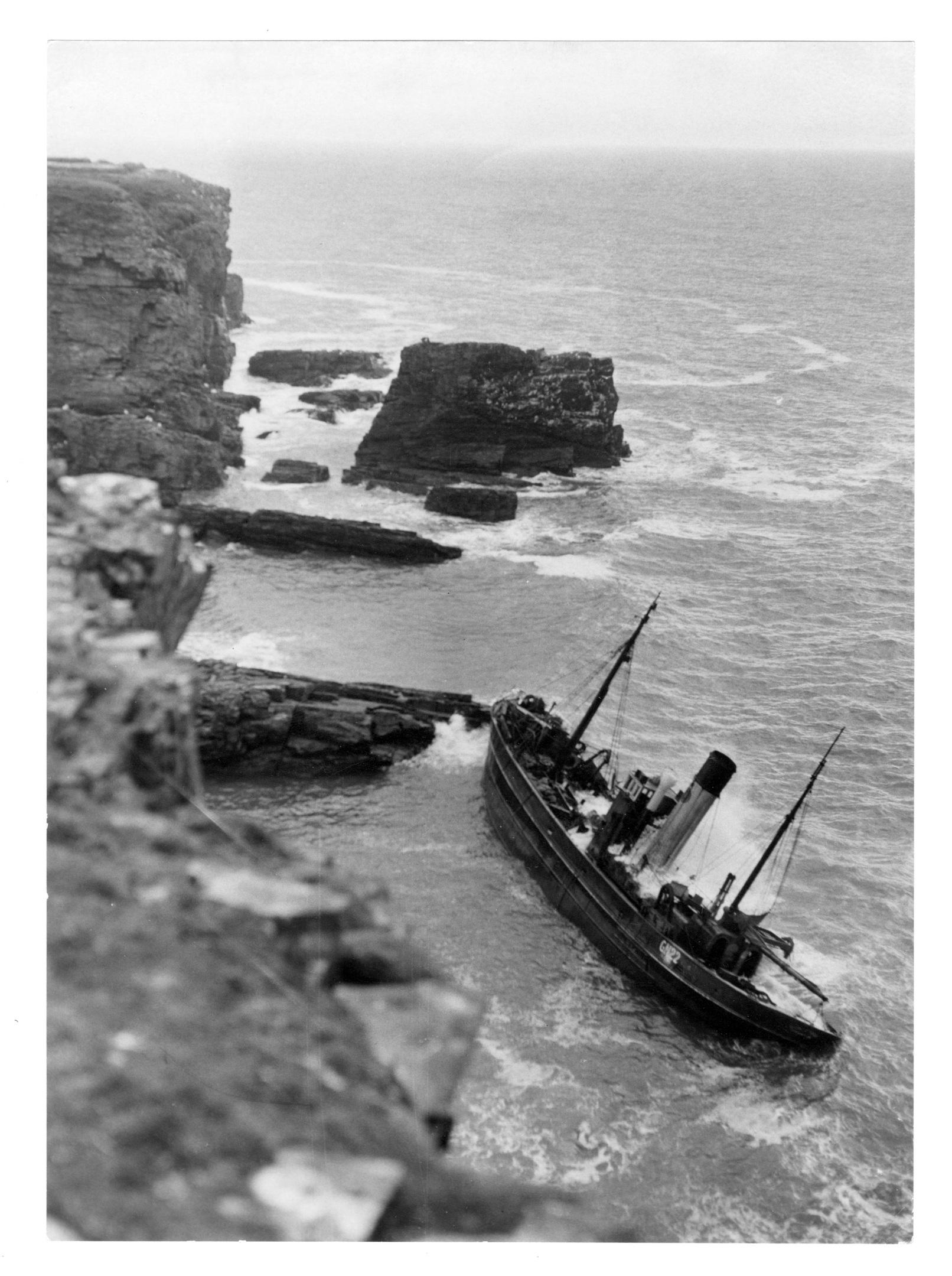 The Granton trawler, Contender, on the rocks near Cruden Bay.