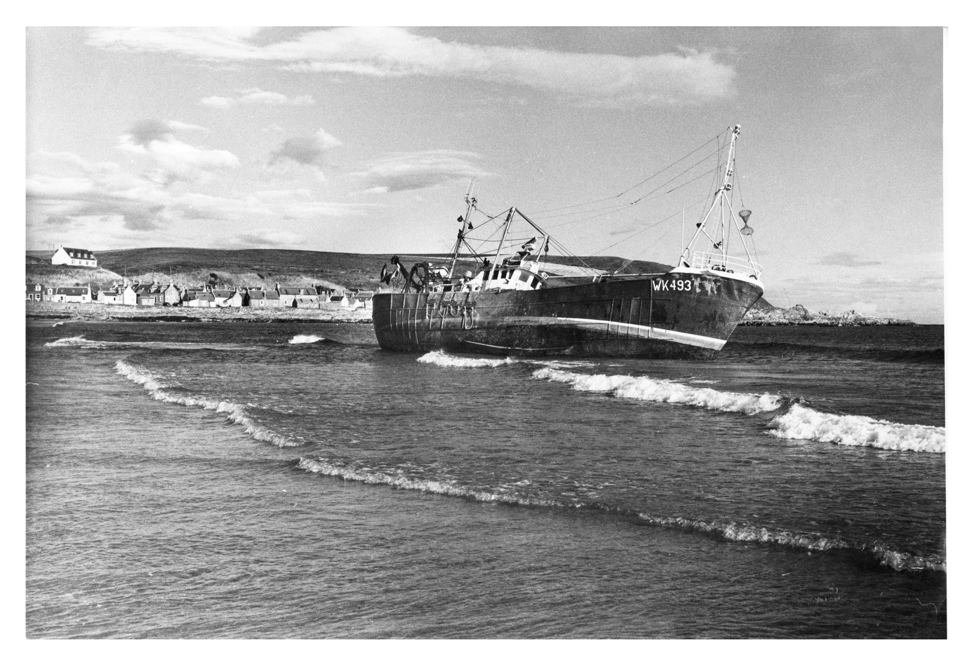 The Wick-registered steel trawler, Fram, aground on the beach at Sandend, near Portsoy.
