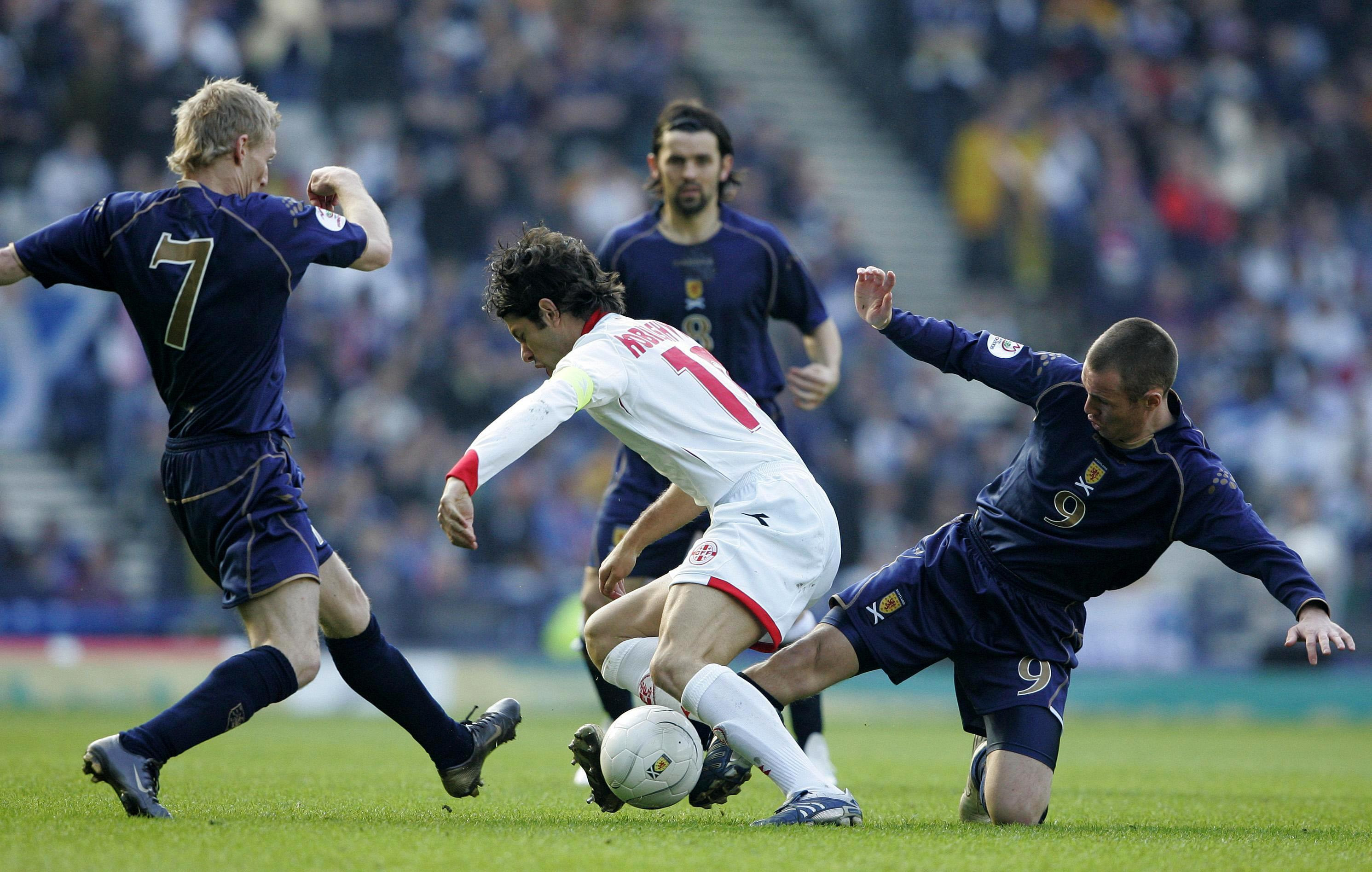 Scotland's Kenny Miller tackles Georgia's Levan Kobiashvili.