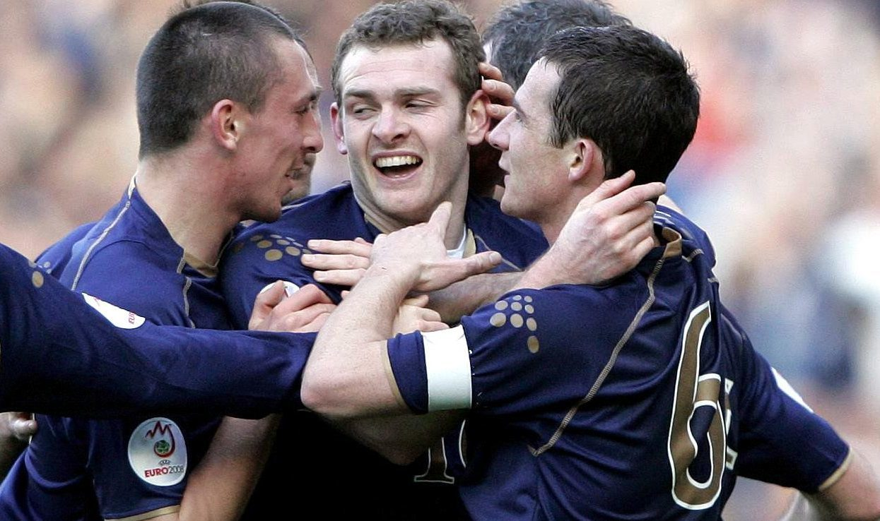 Scotland's Craig Beattie, centre, celebrates scoring the winning goal against Georgia.
