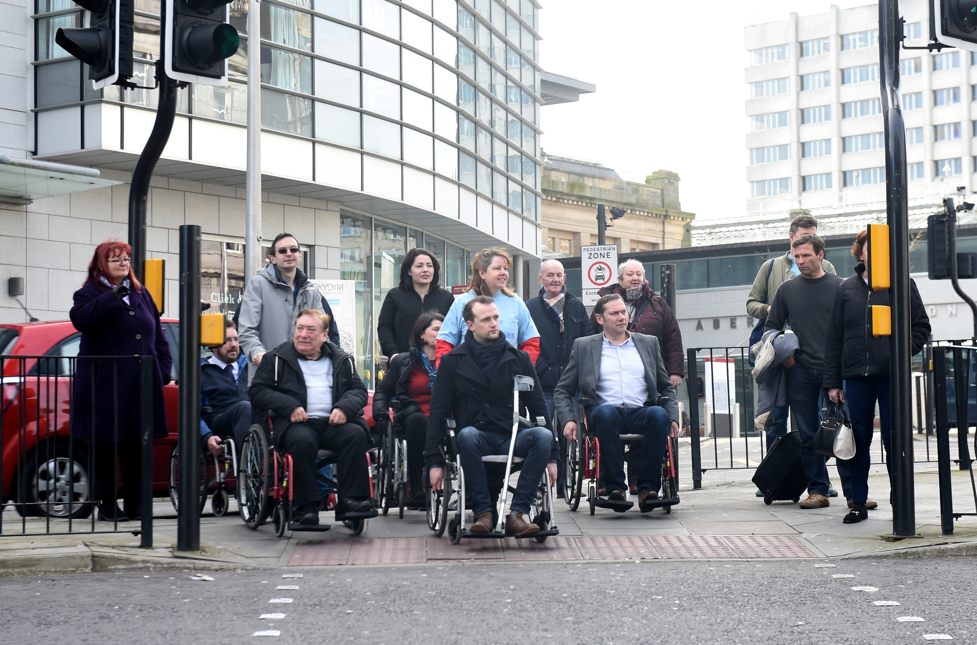The Aberdeen city councillors began their mile-long journey by  wheelchair from  Union Square in the city centre.
