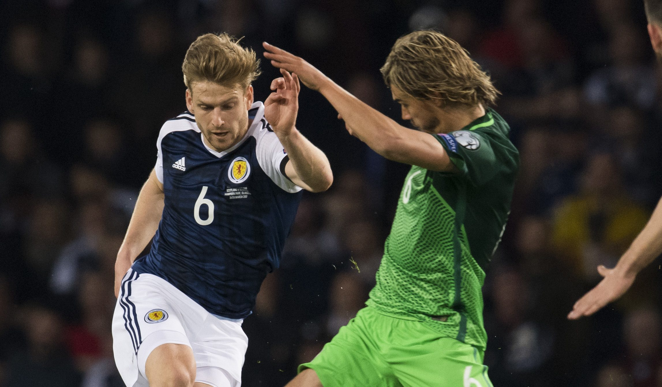 Scotland's Stuart Armstrong took on Slovenia's  defence.