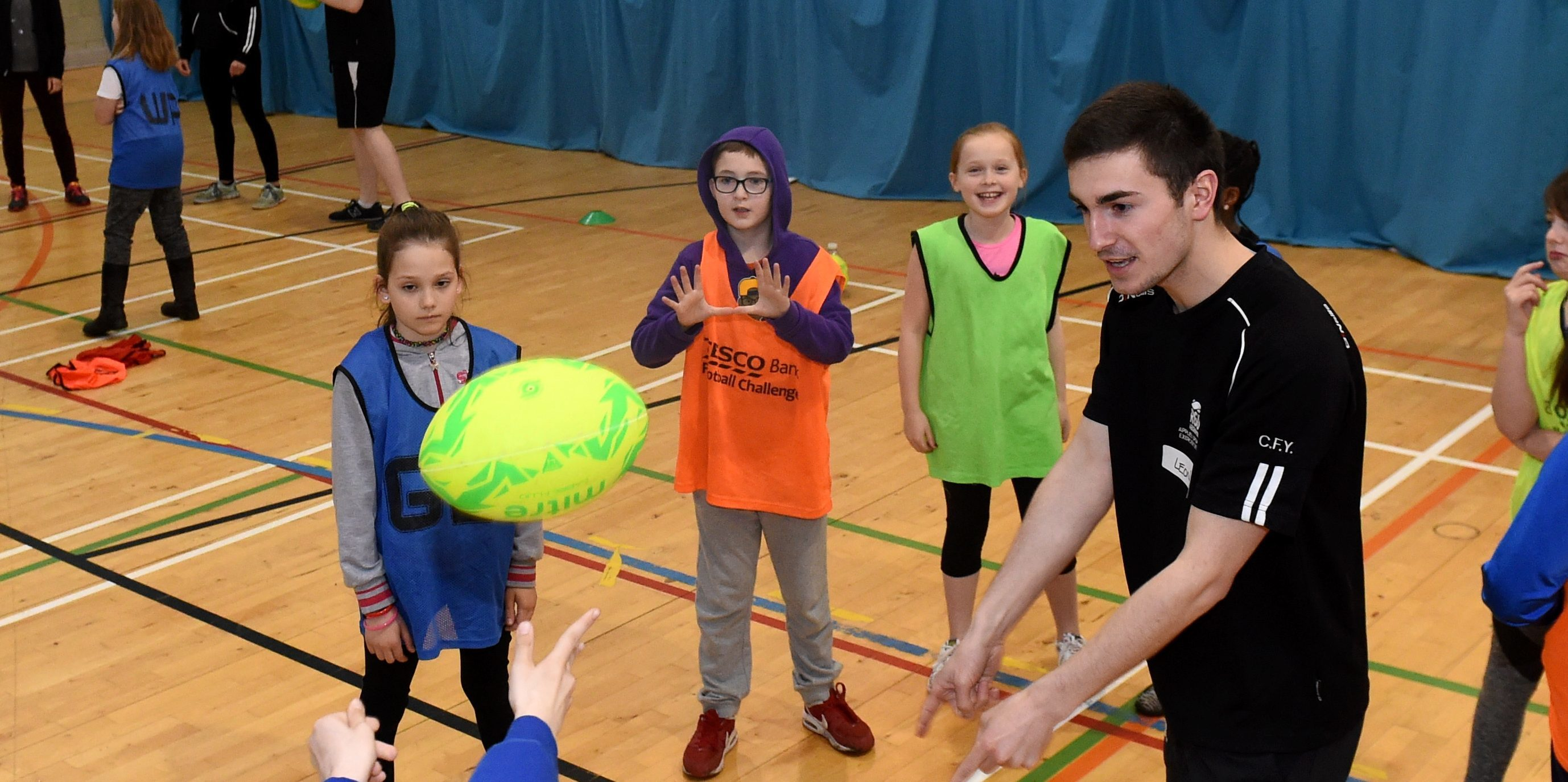 Children from Kaimhill School join in the coaching from RGU students.  (Pictures by Darrell Benns.)