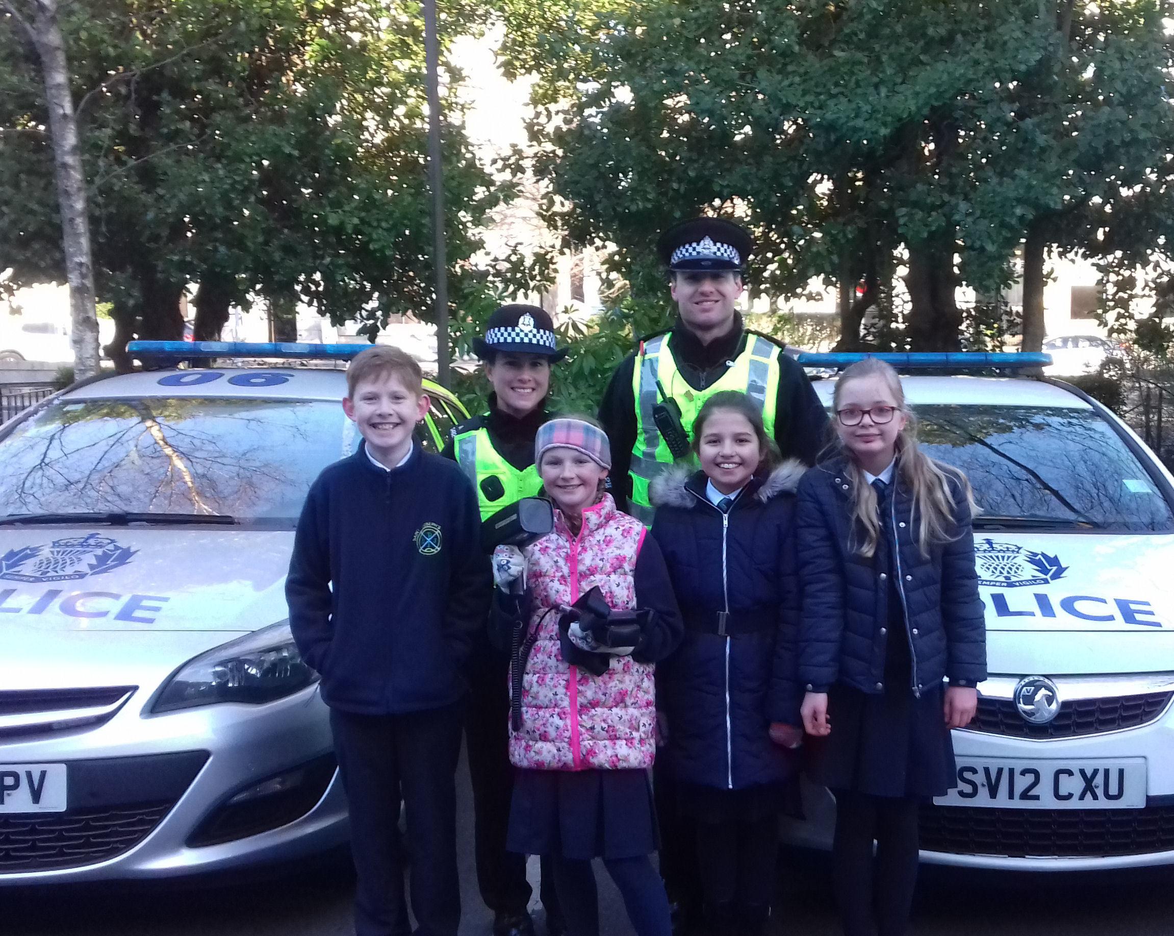 Pupils from St Joseph's School in Aberdeen with PCs Robyn Watt and PC Jake Balderson.