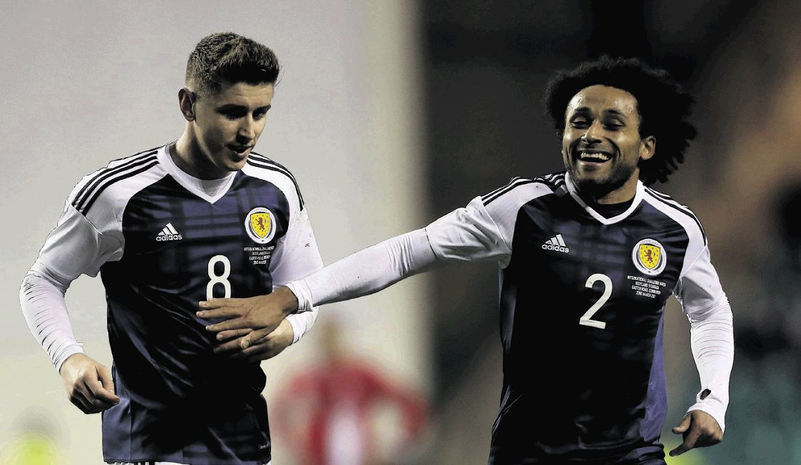 Ikechi Anya, right, with Tom Cairney.
