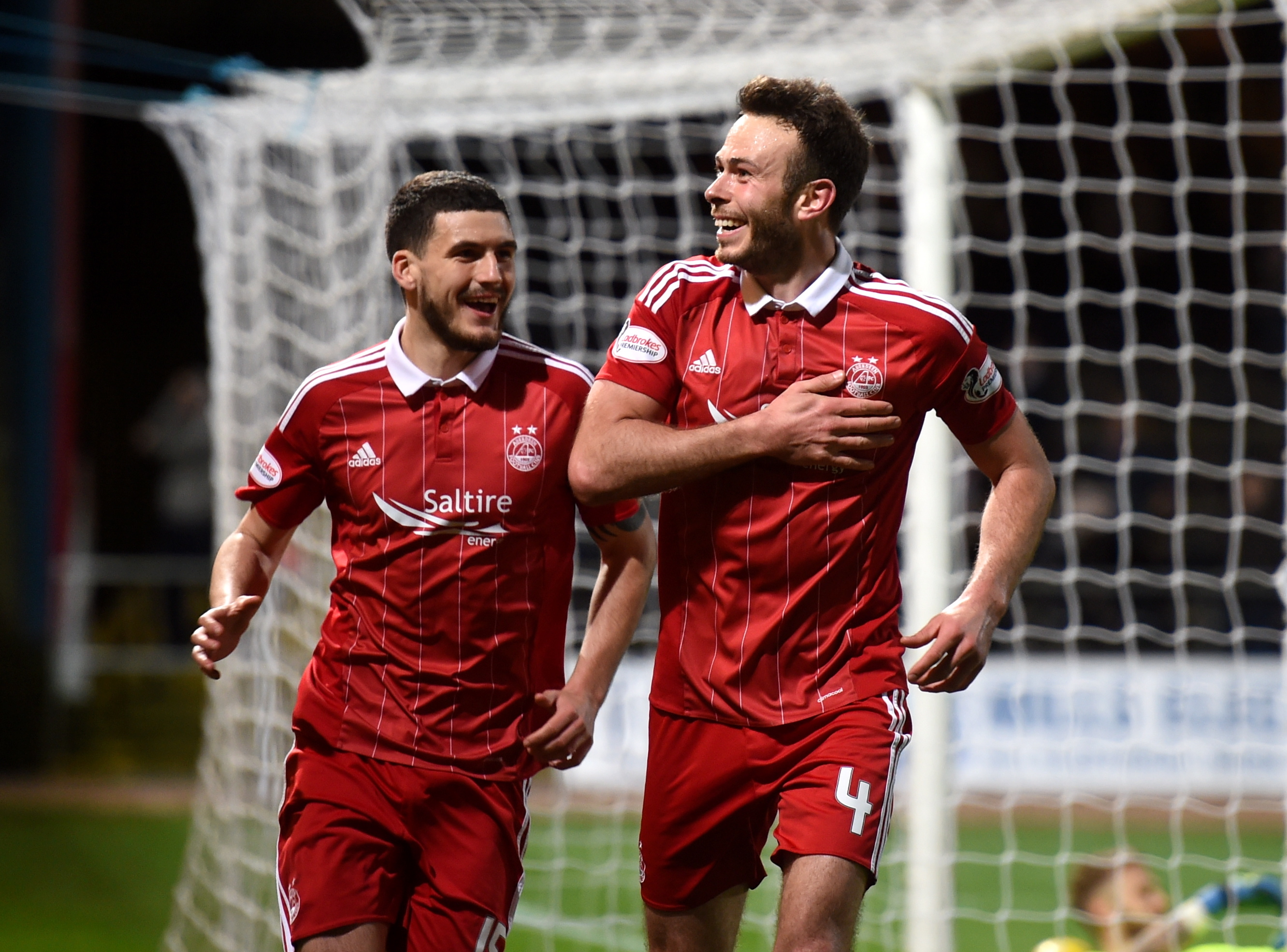 Aberdeen's Andrew Considine wheels away after capping off a remarkable hat-trick at Dundee. (Picture by Darrell Benns.)