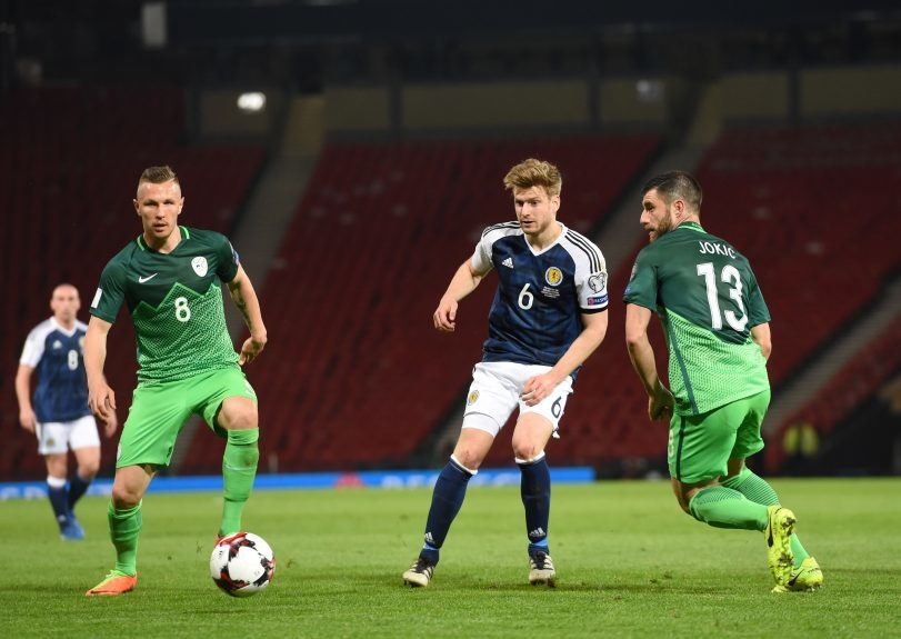 Scotland v Slovenia 2018 Fifa World Cup Qualifier Hampden Park, Glasgow Pictured is Scotland's Stuart Armstrong playing a pass beyond Slovenia's Jasmin Kurtic and Bojan Jokic Picture by DARRELL BENNS     Pictured on 26/03/2017