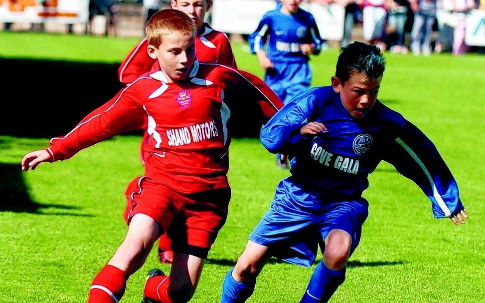 Ryan Fraser, right, in action for Cove Madrid in 2004.